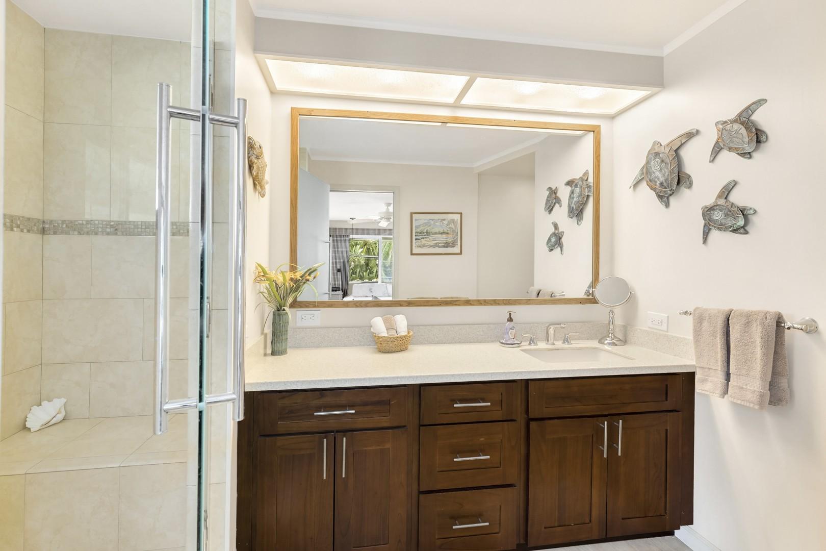Master ensuite bathroom upstairs with custom shower.