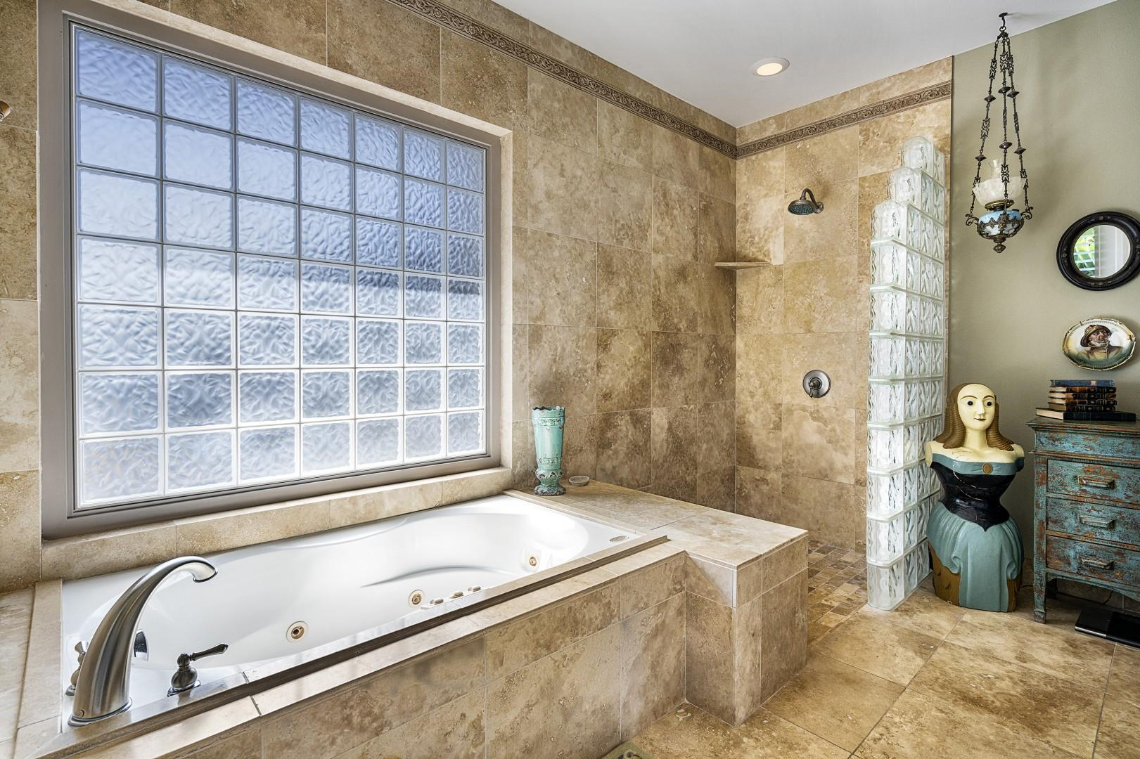 Large soaking tub and walk-in shower can be found in the Master suite