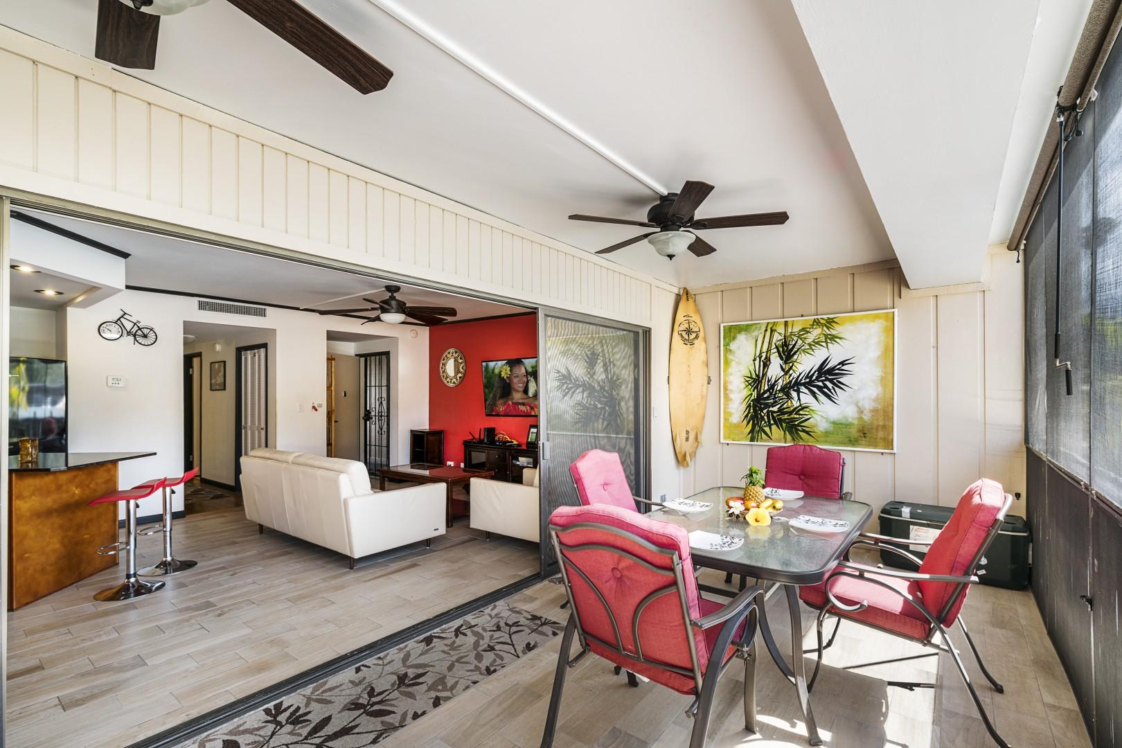 Large sliders make the Lanai feel like an extension of the living room!