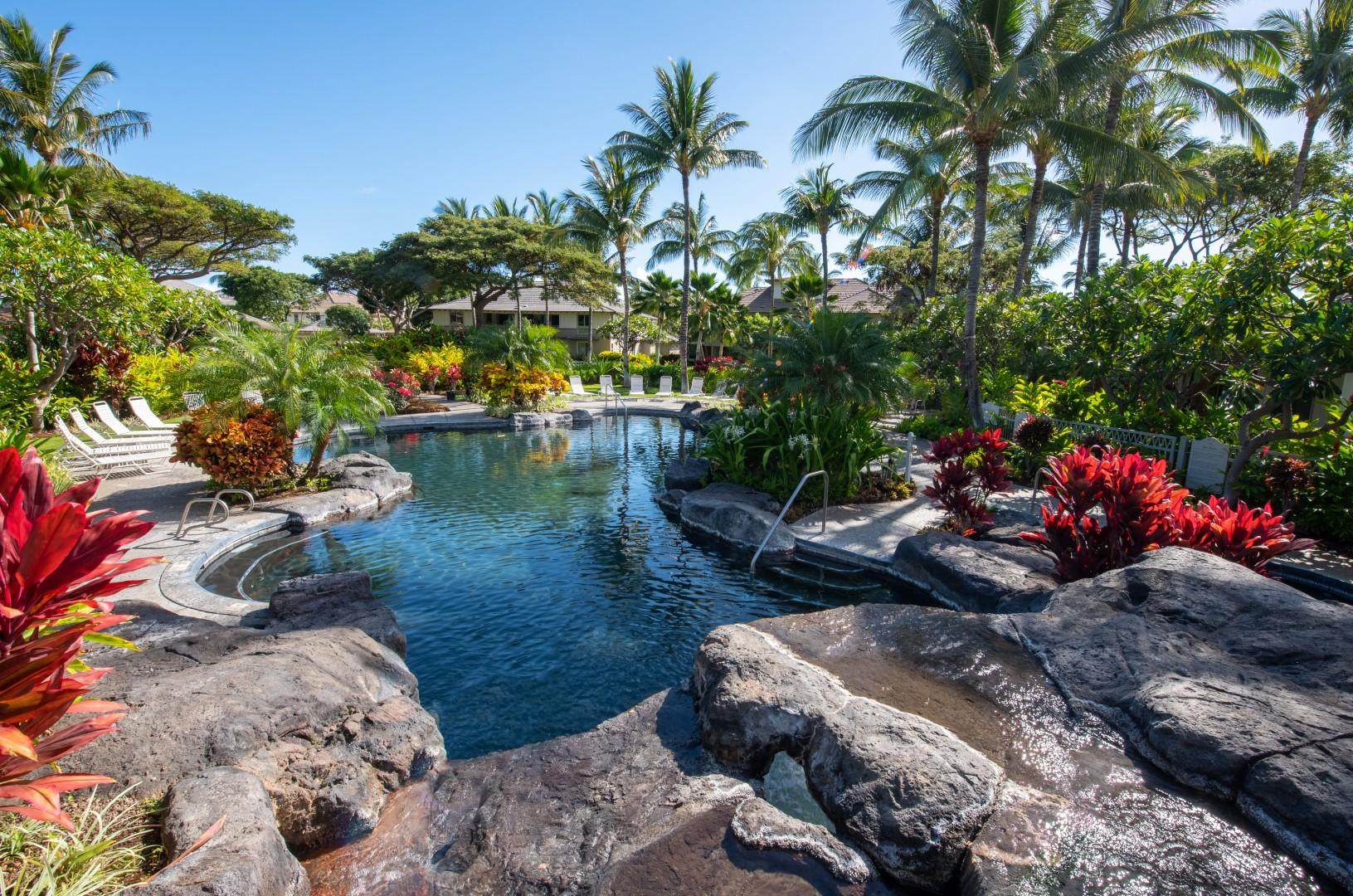 Spacious Swimming Pool w/ Waterfall, Surrounded by Lush Tropical Landscape