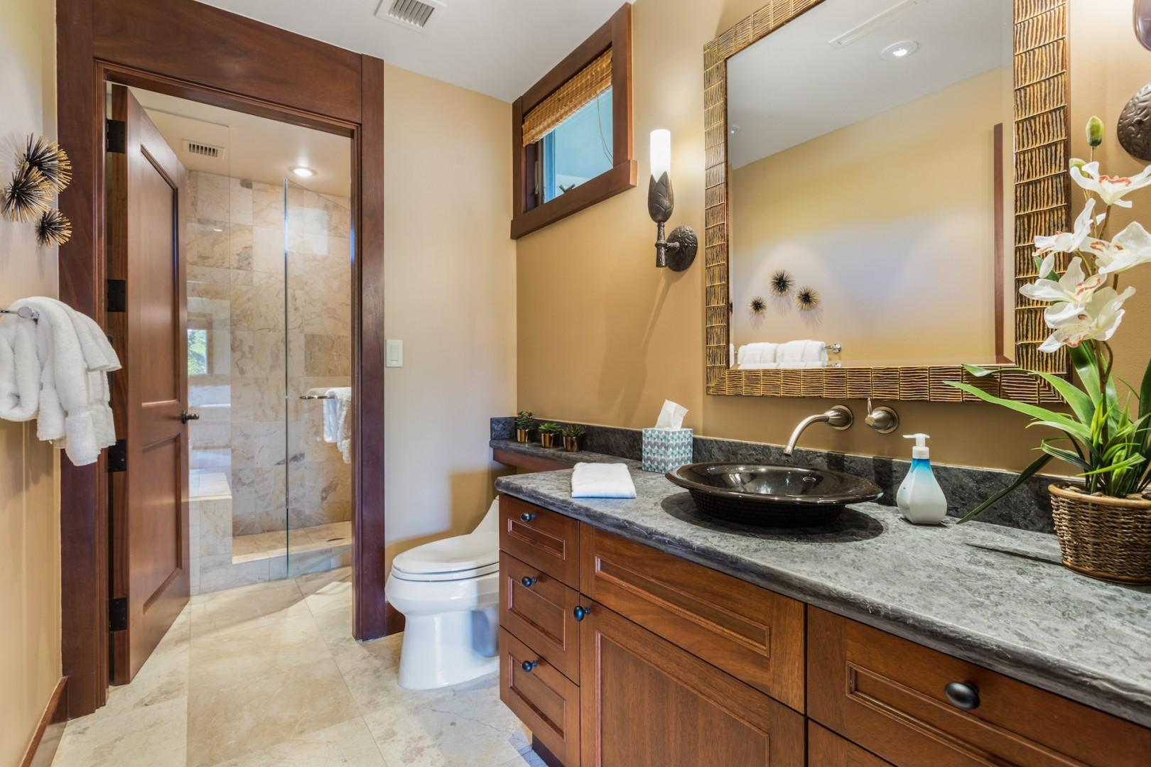 Third full bath, detached, with chic fixtures and walk-in shower.