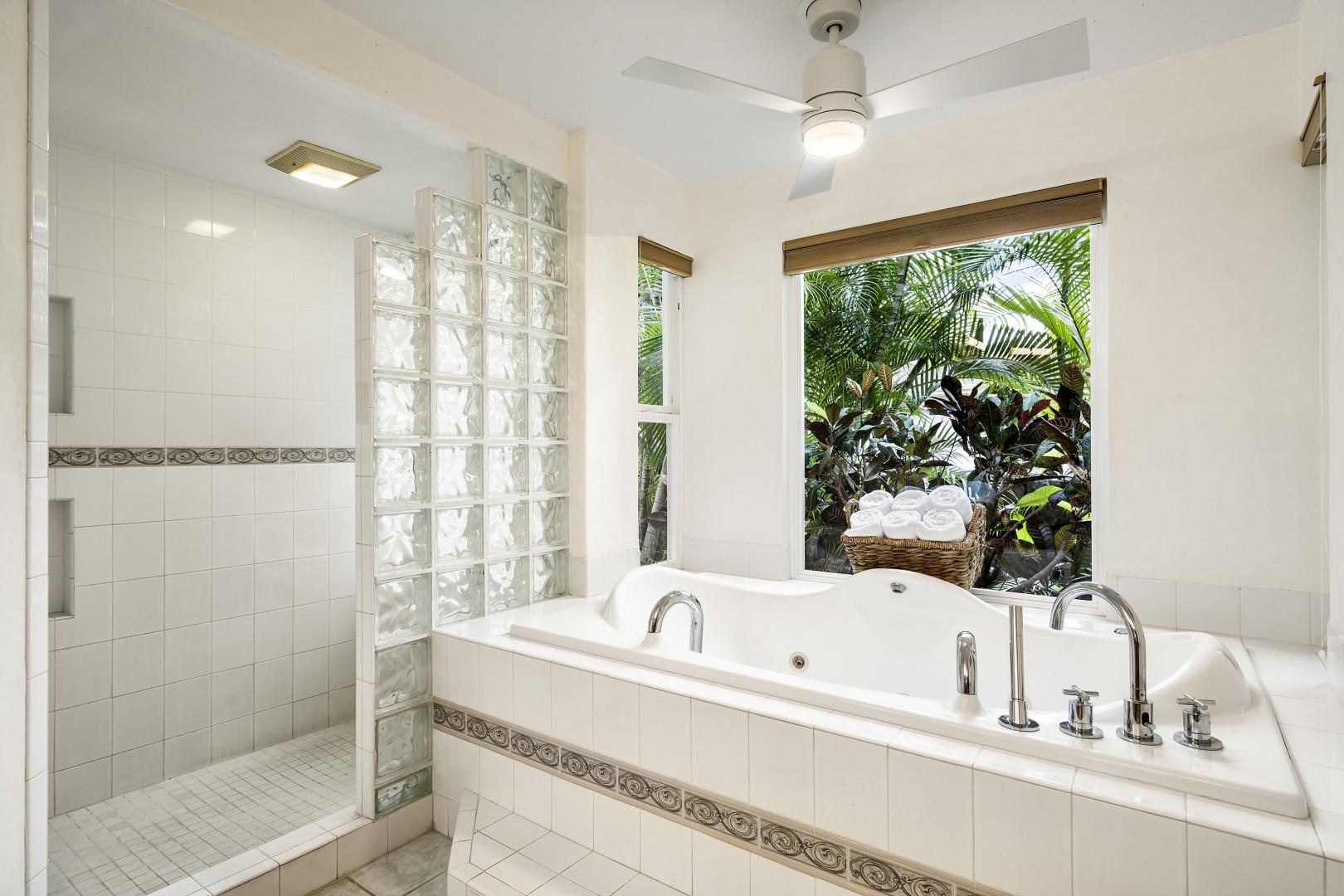 Oversized jetted soaking tub in the master bathroom