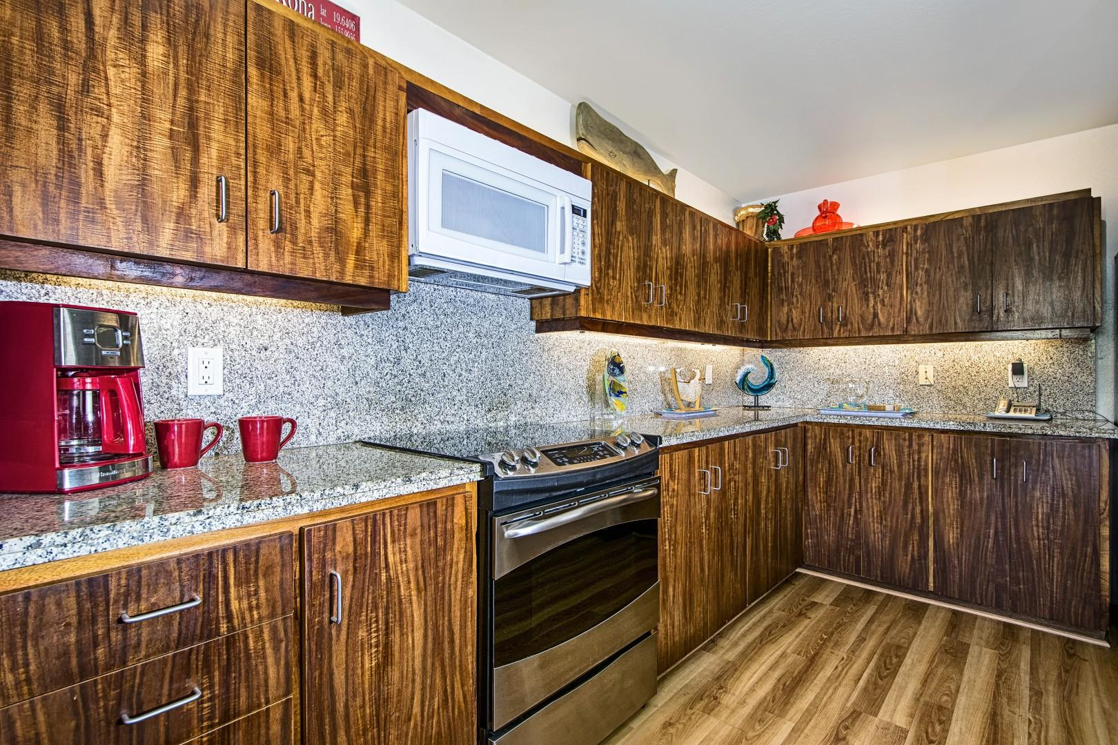Spacious kitchen with granite counters and upgraded appliances!