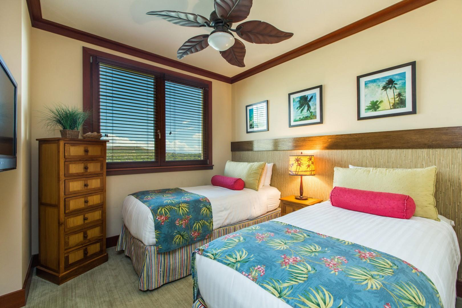 2nd bedroom with two twin beds (converted to King with advance request), wall mounted TV, ceiling fan, dresser, mountain and golf course views