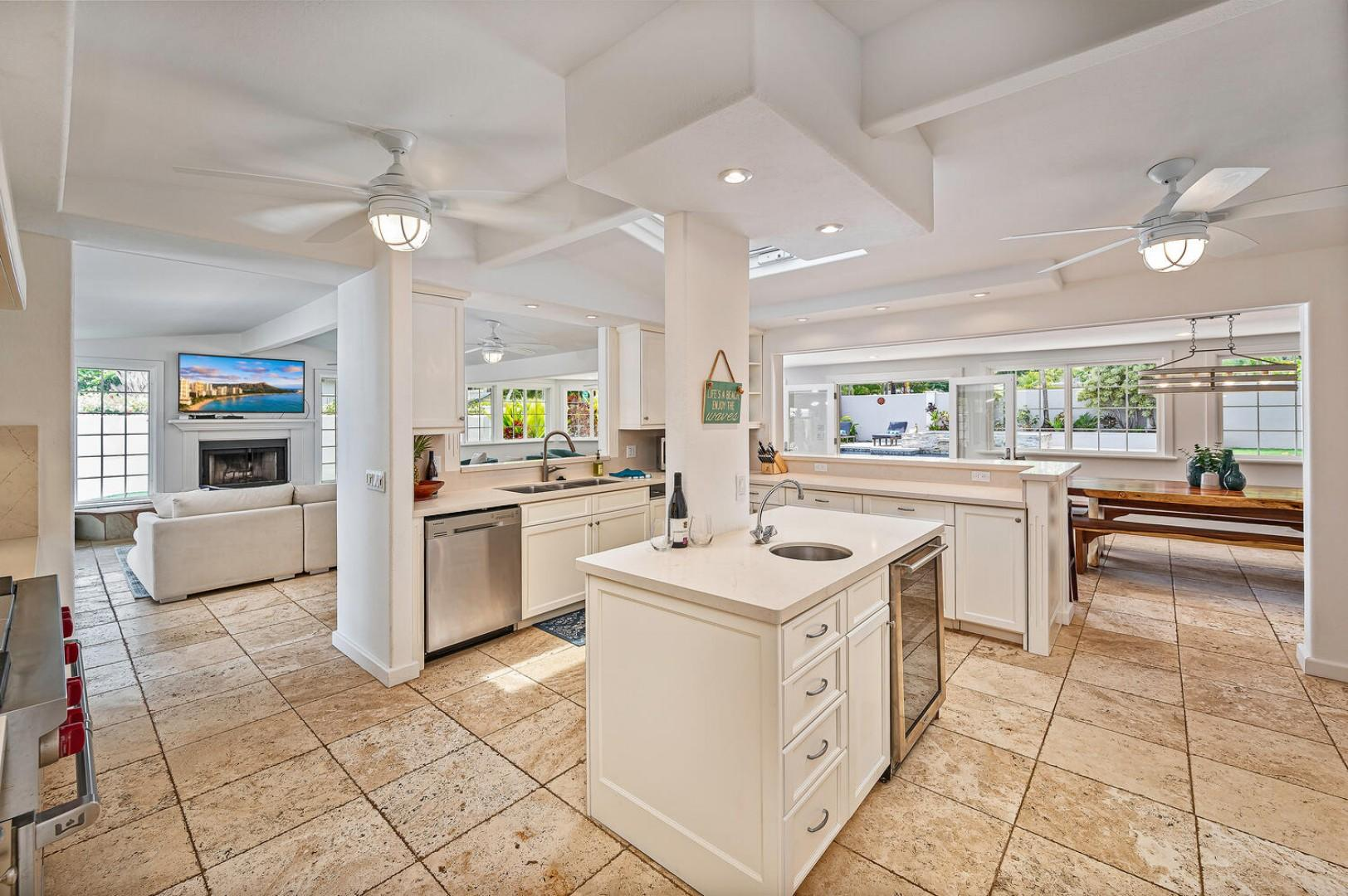 Open concept chefs kitchen with top of the line appliances.