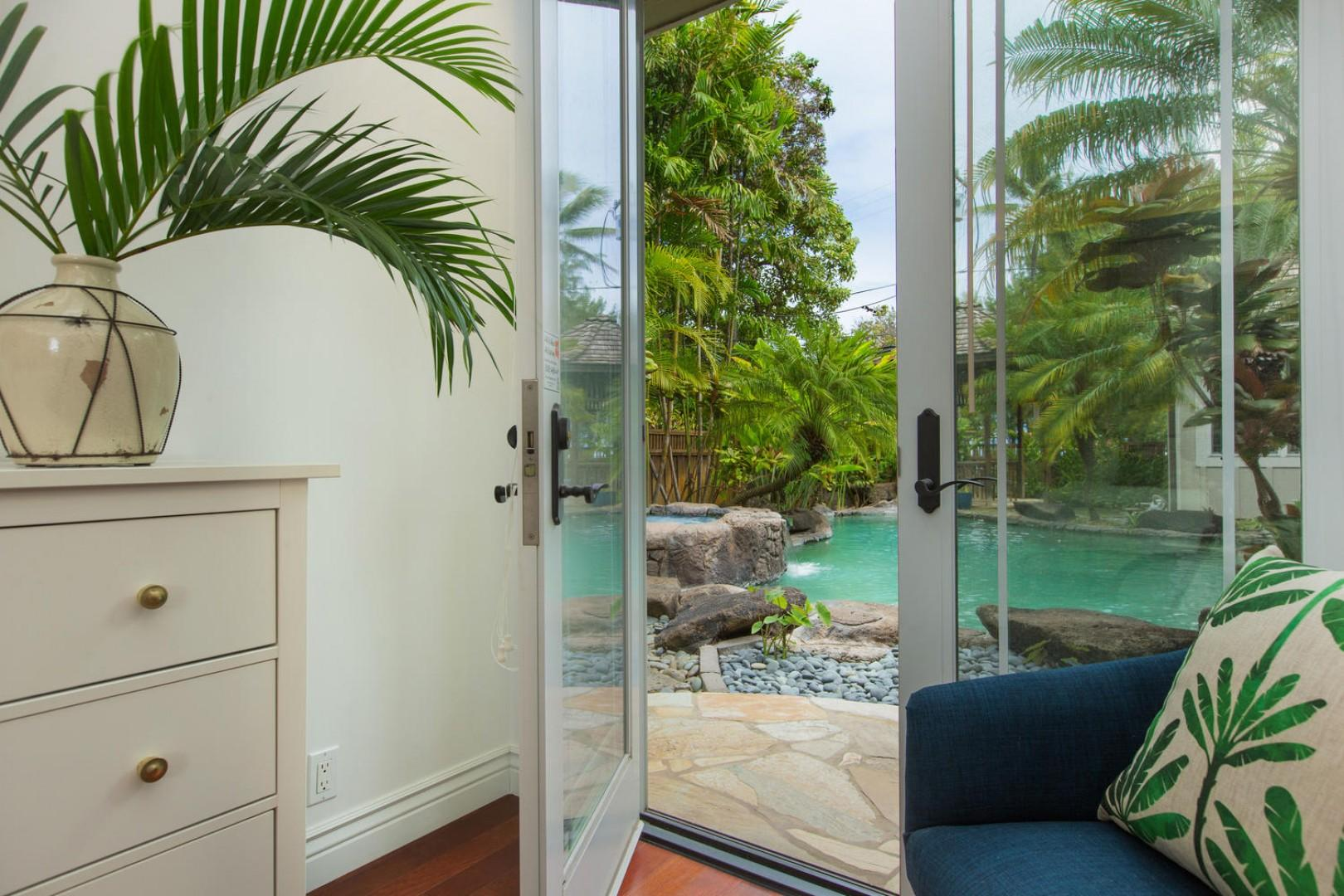 Lanai doors off master bedroom lead to the pool courtyard.