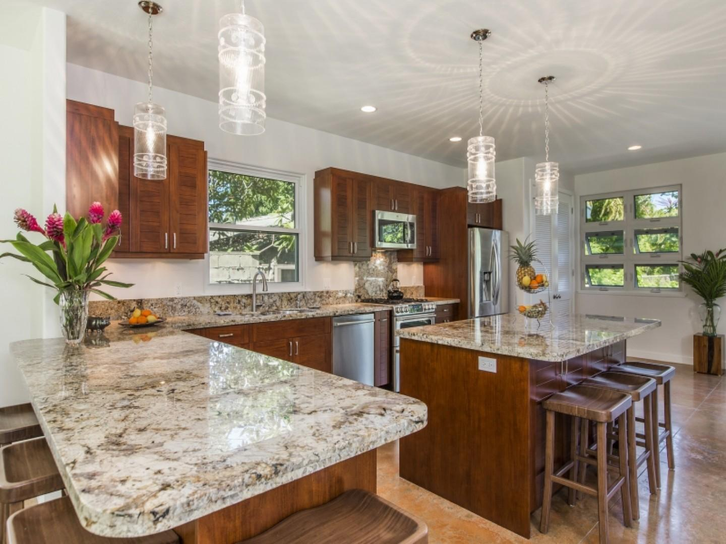 Beautiful granite counters with ample seating.
