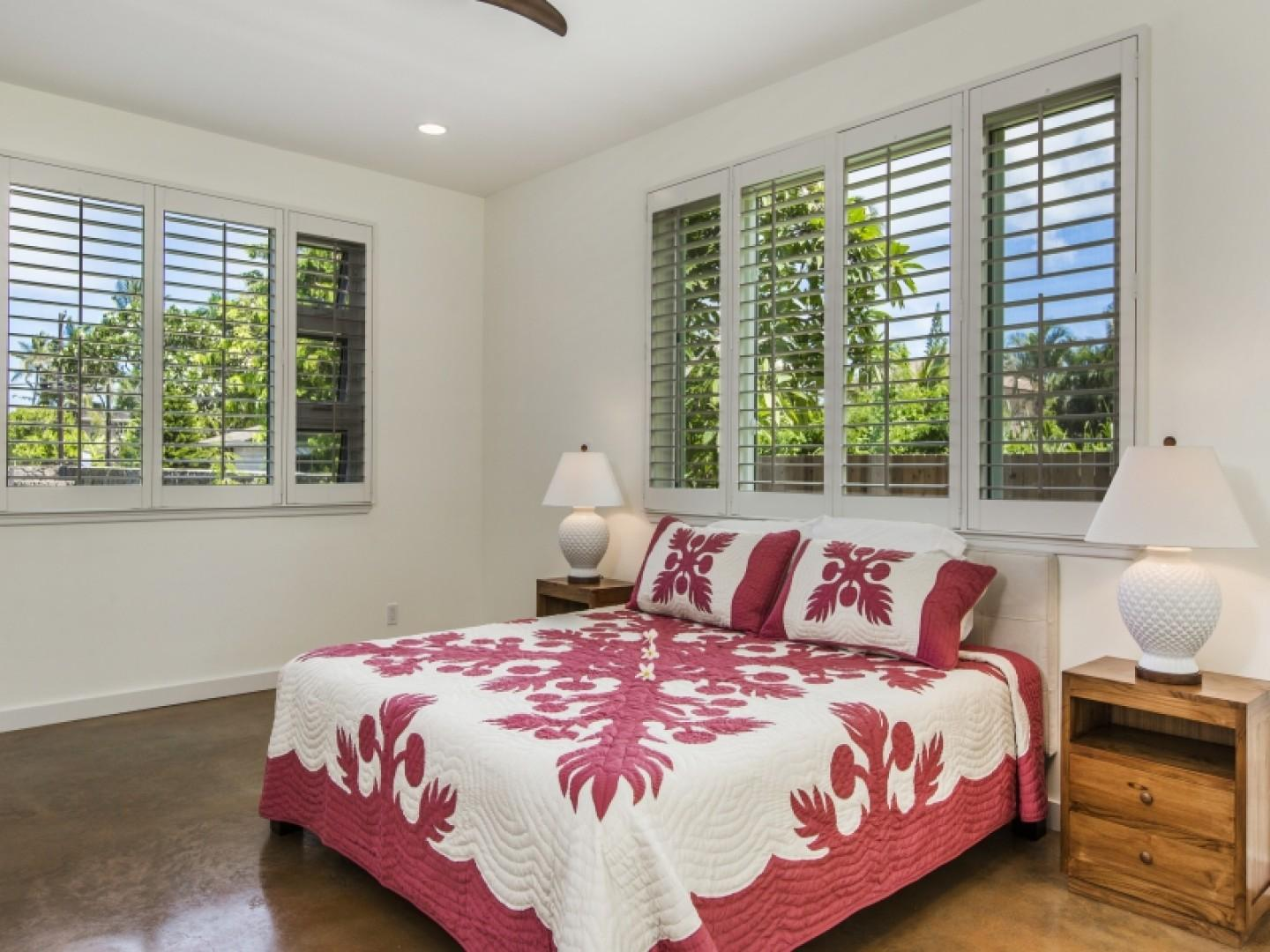 Adjustable plantation shutters allow light in according to your liking.