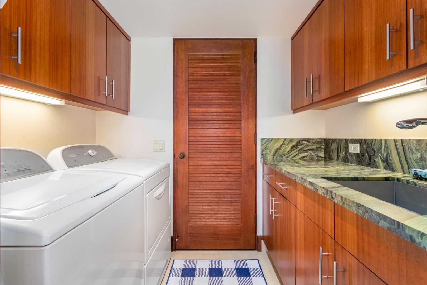 Spacious and well-appointed laundry room.