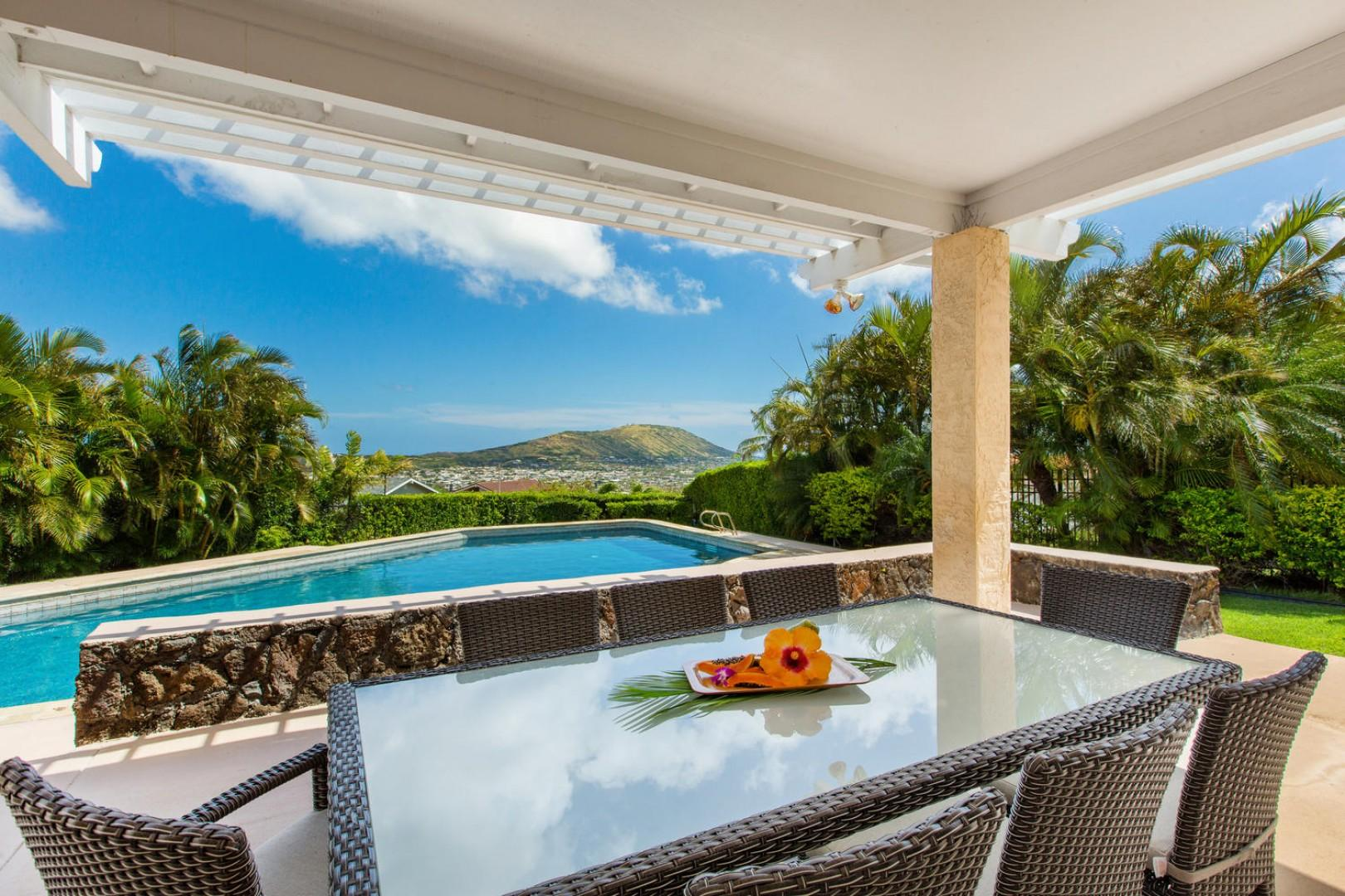 Outdoor seating by the pool overlooking Portlock and Koko Crater.