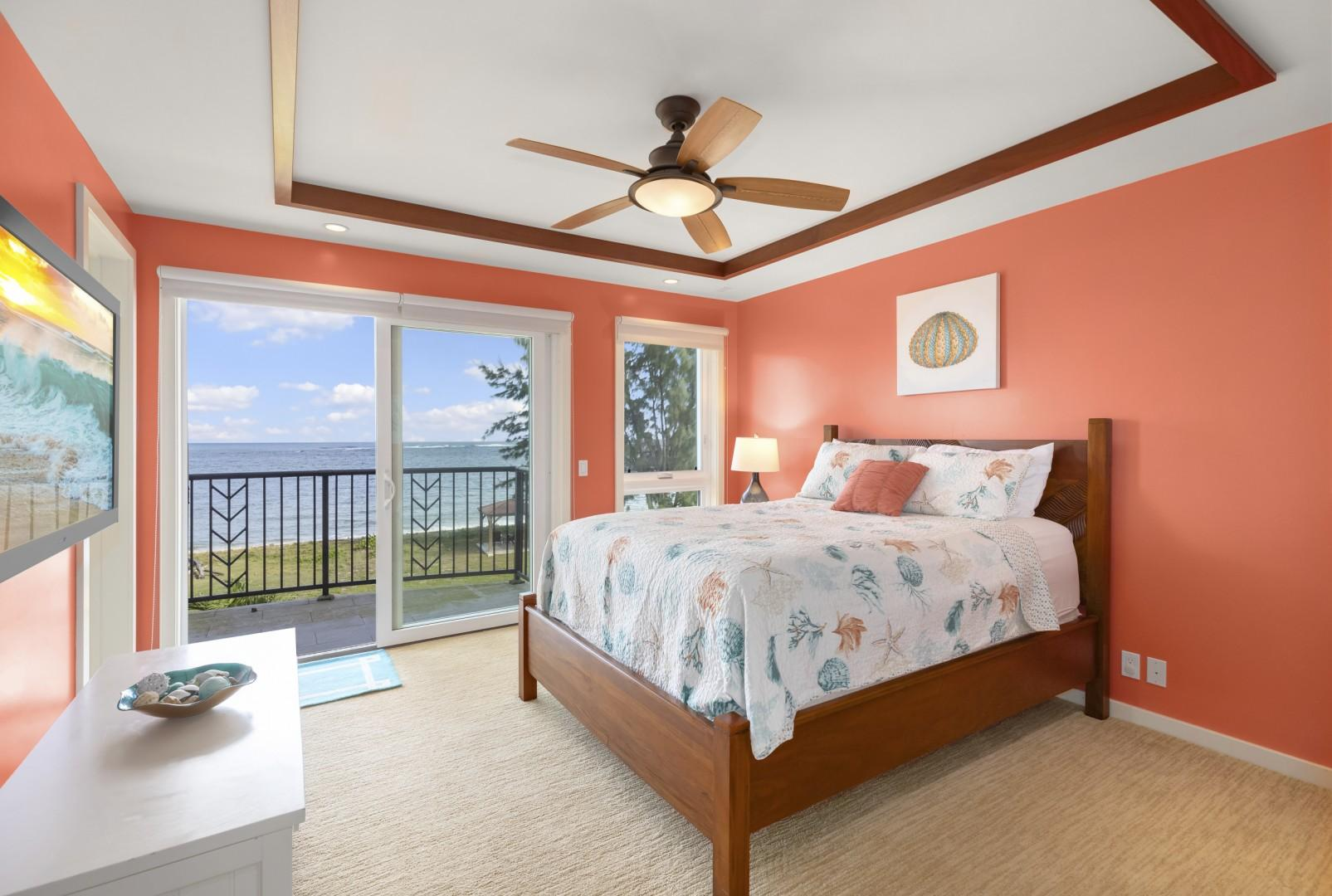Junior master suite with pillow-top queen bed and balcony with view of pool and ocean.