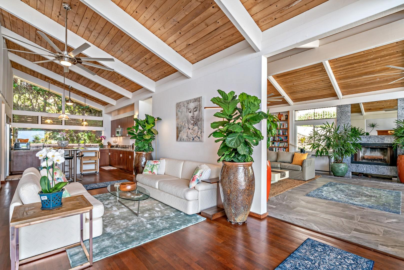Open floor plan with sliding glass doors that open up to the pool deck.