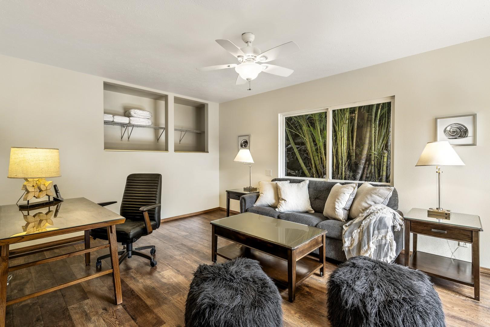 Office features an attached half bathroom and Queen sleeper sofa with A/C