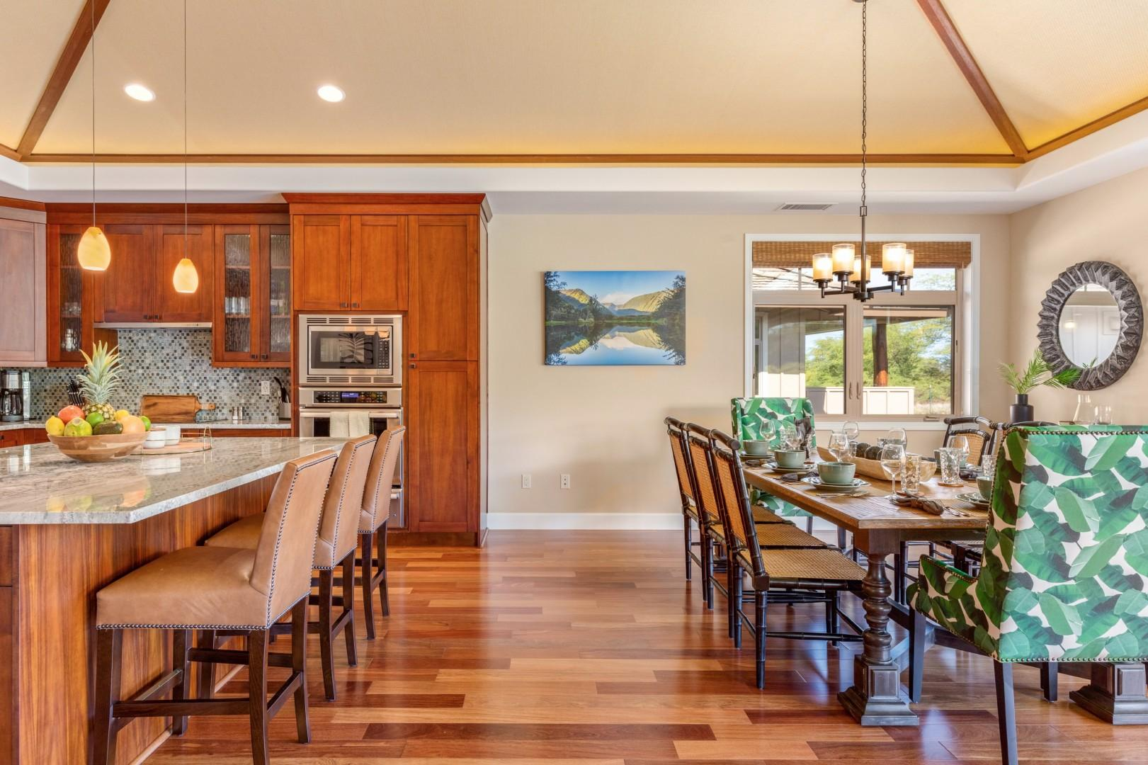 Breakfast bar and dining table for eight framed by soaring vaulted ceilings.