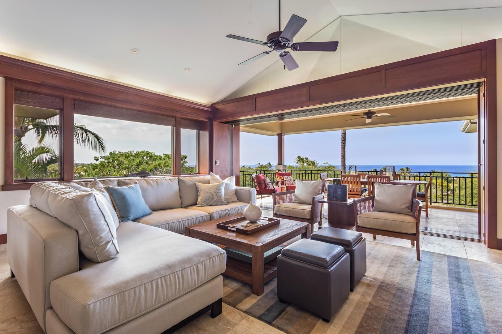 Abundant natural light and ocean views in the living area, with sliding glass pocket doors out to the lanai.