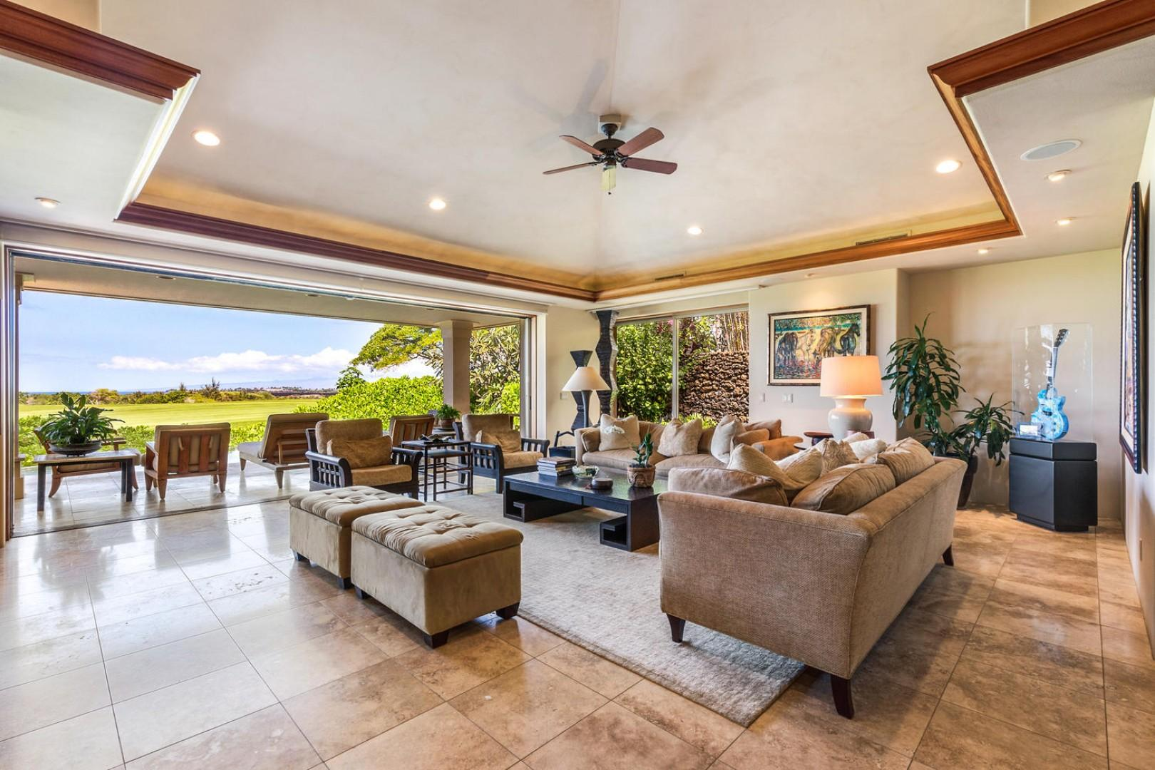 Living area with valance ceilings, recessed lighting, and sliding glass pocket doors to lanai & pool deck.