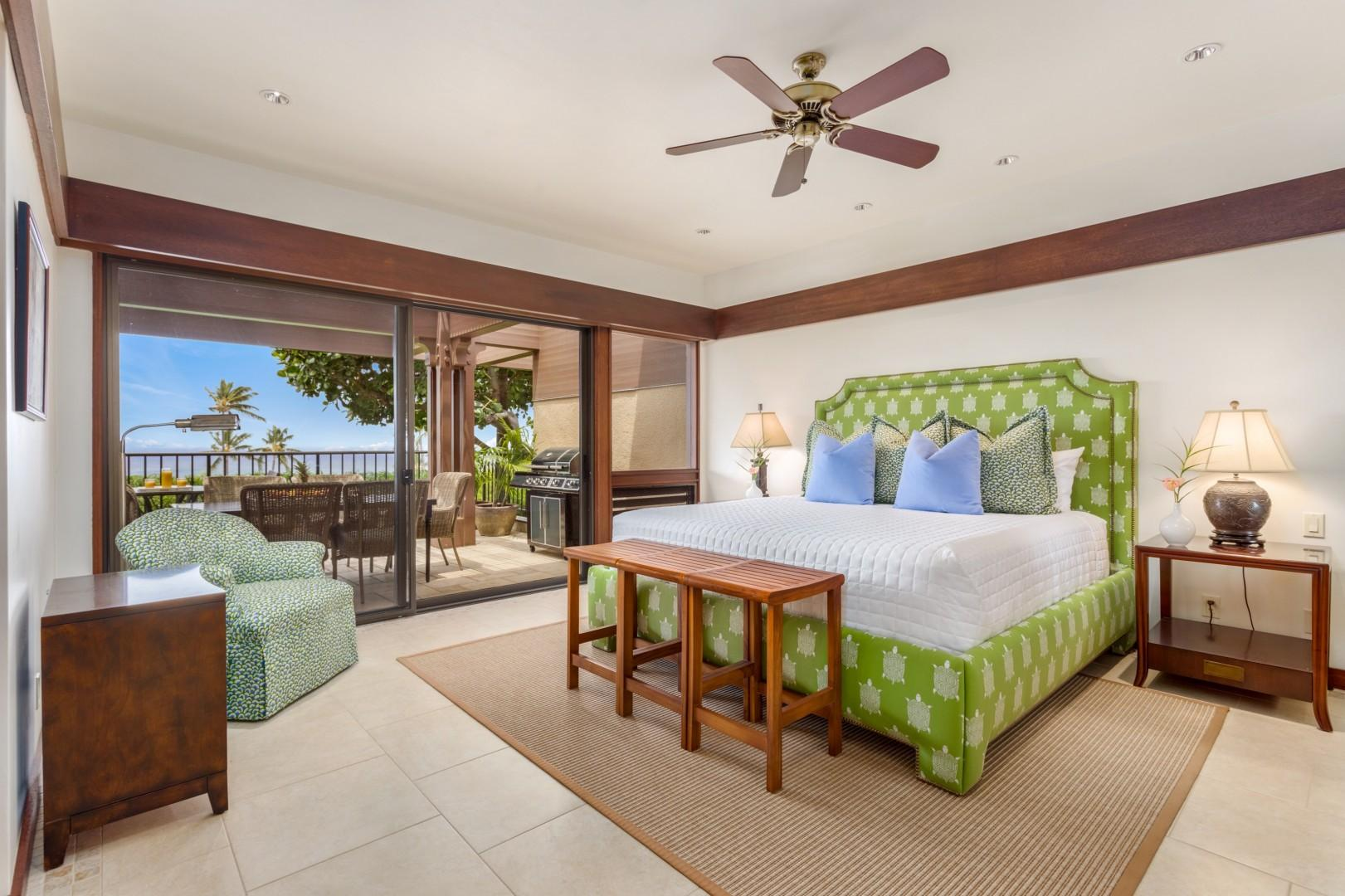 Second bedroom, with king bed, flat-screen TV, sliding glass doors to upper lanai, and ocean views.