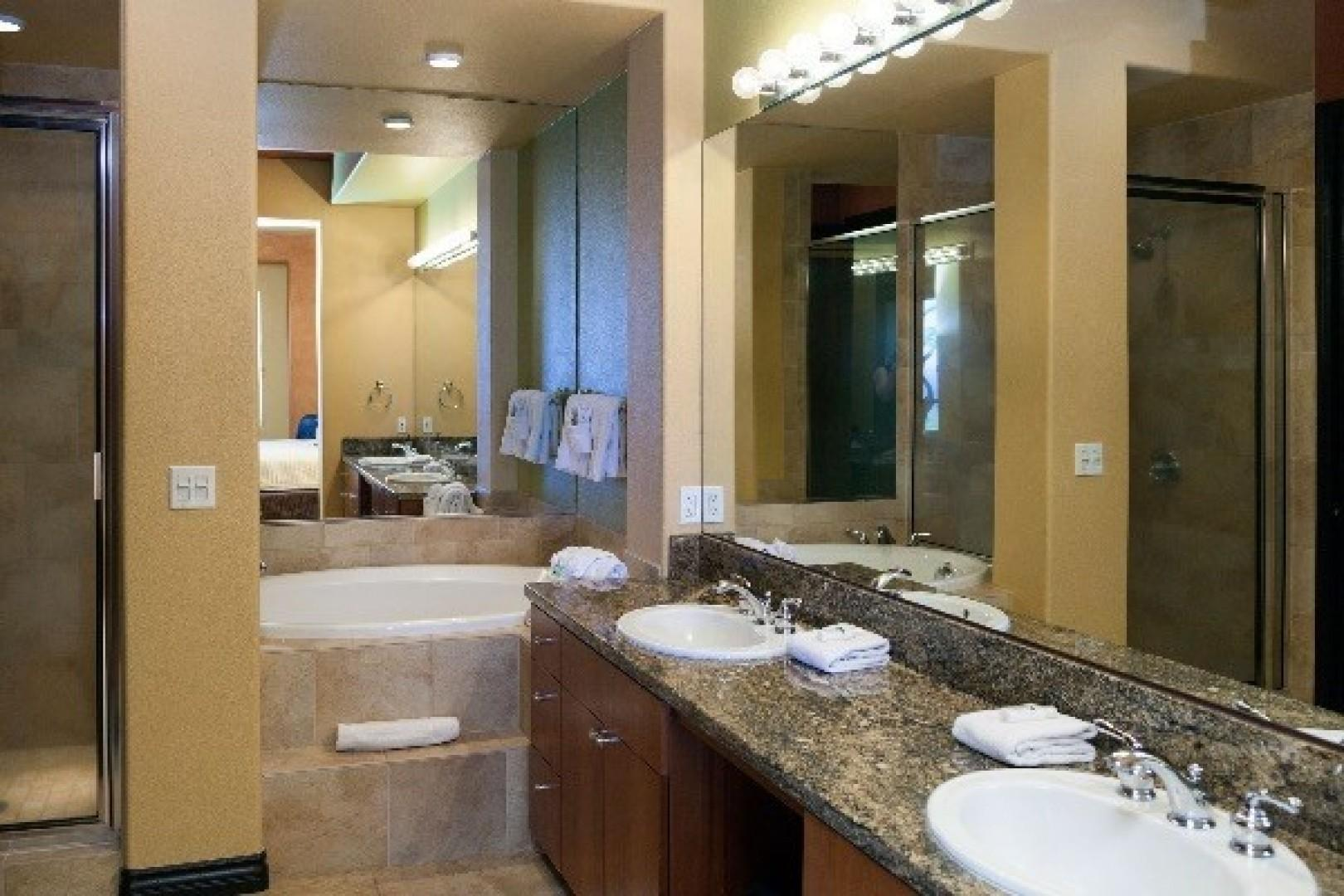 Master Bathroom with dual sinks, walk in shower, soaking tub and private toilet room.
