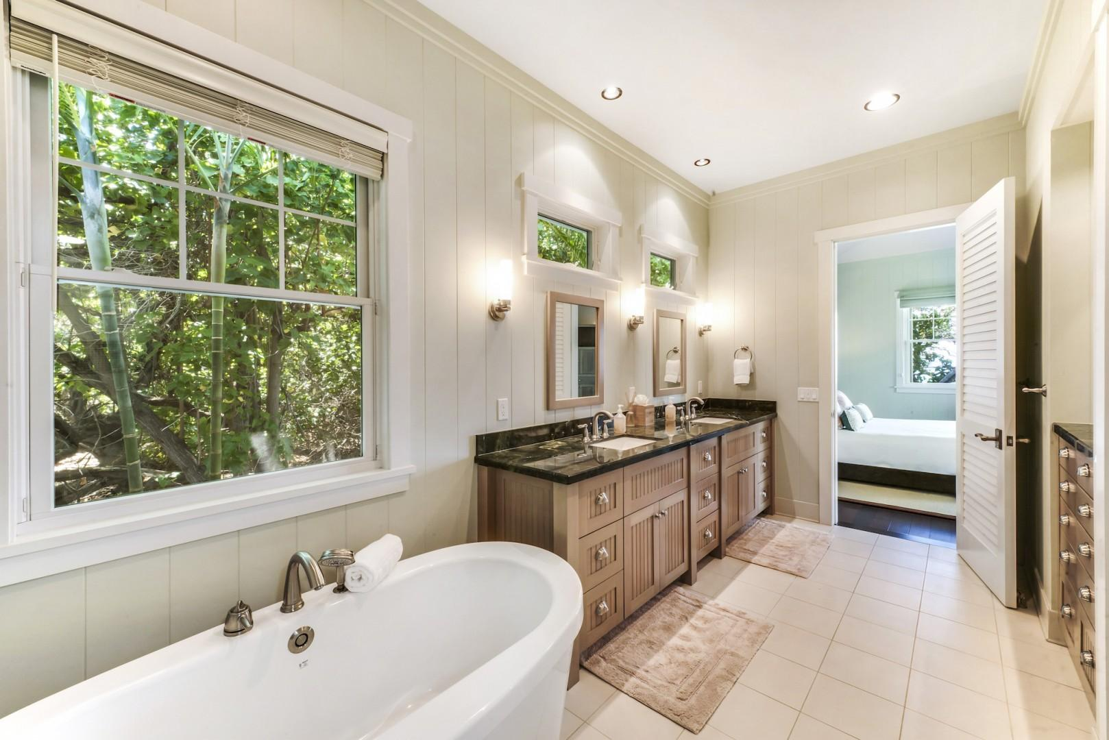 Master Bath w/ Luxurious Soaking Tub, Separate and Spacious Tiled Shower w/ Double Shower Heads, Skylight & Tiled Bench, Granite Countertops, Double Sink Vanity and Separate Water Closet.