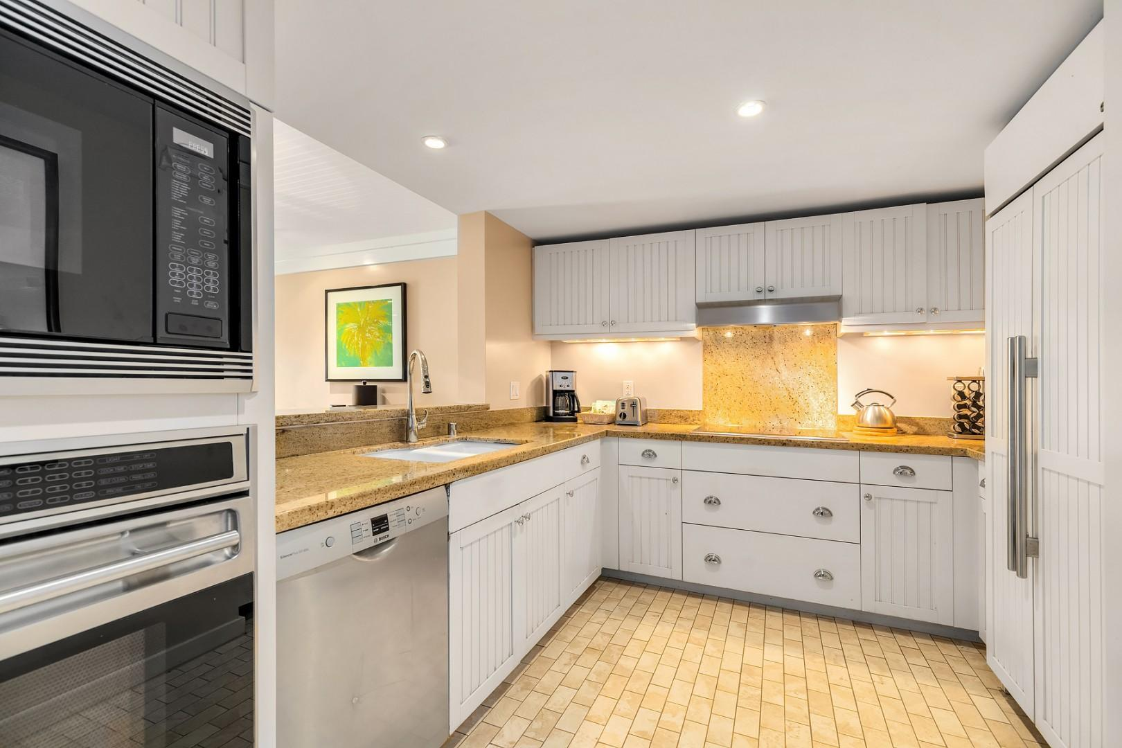 Chef's kitchen with high end appliances and built in refrigerator.