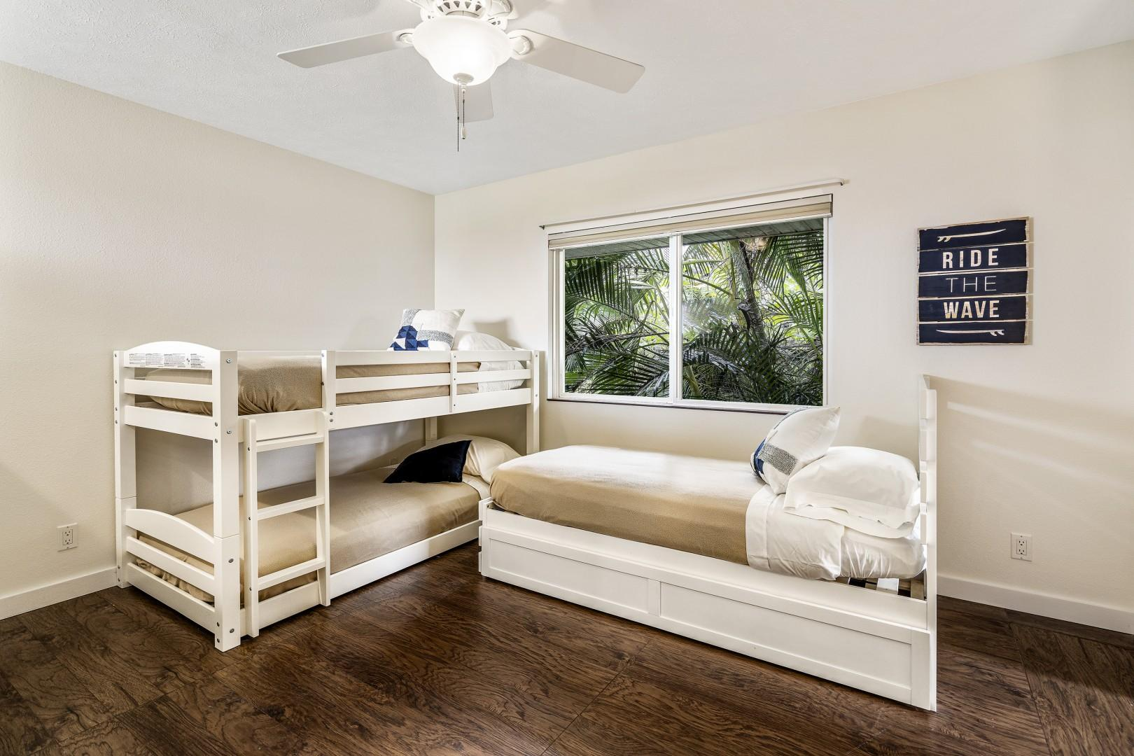 Upstairs kids room featuring 4 twin beds!
