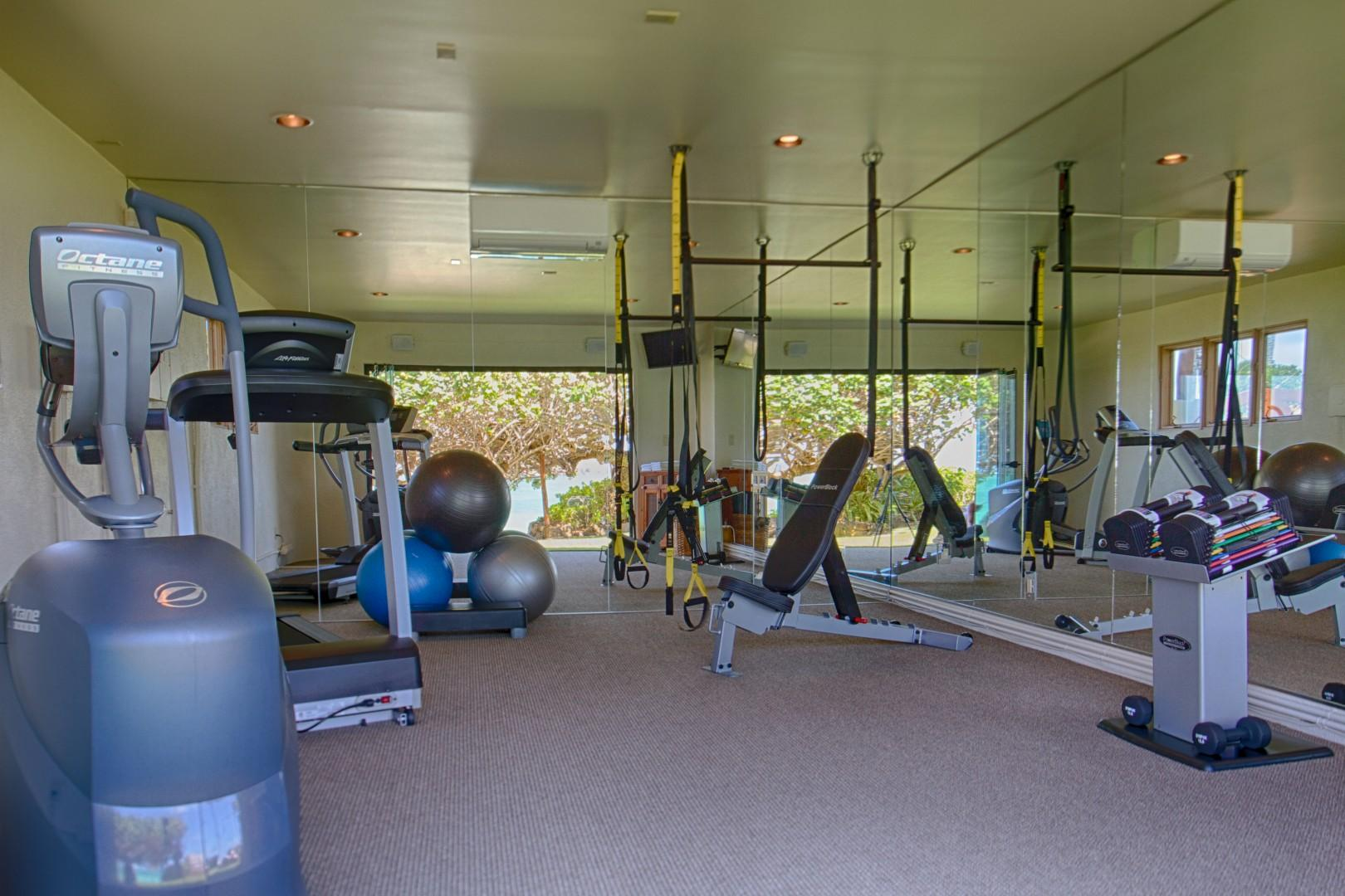 Gym with glass sliding doors and full ocean view