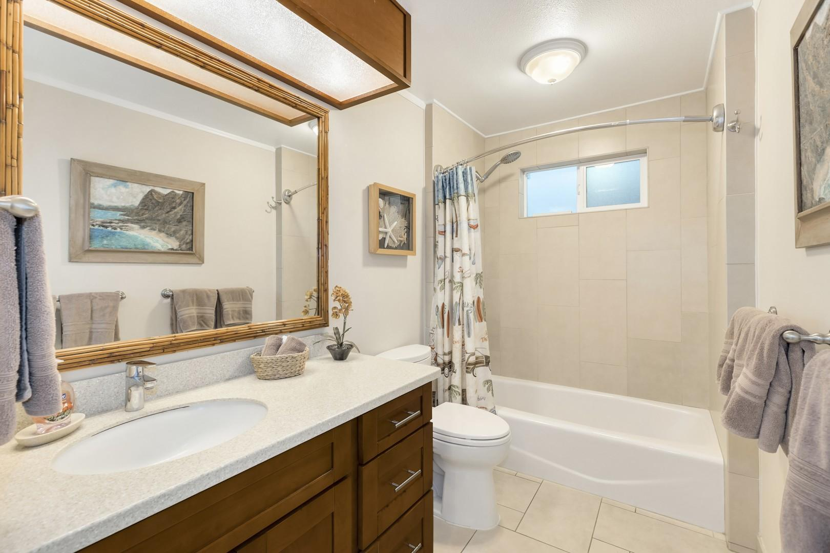Downstairs guest bathroom with tub.