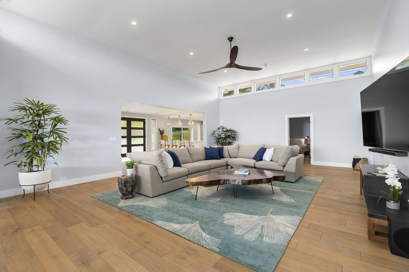 Open living area with smart TV and oversized sectional sofa
