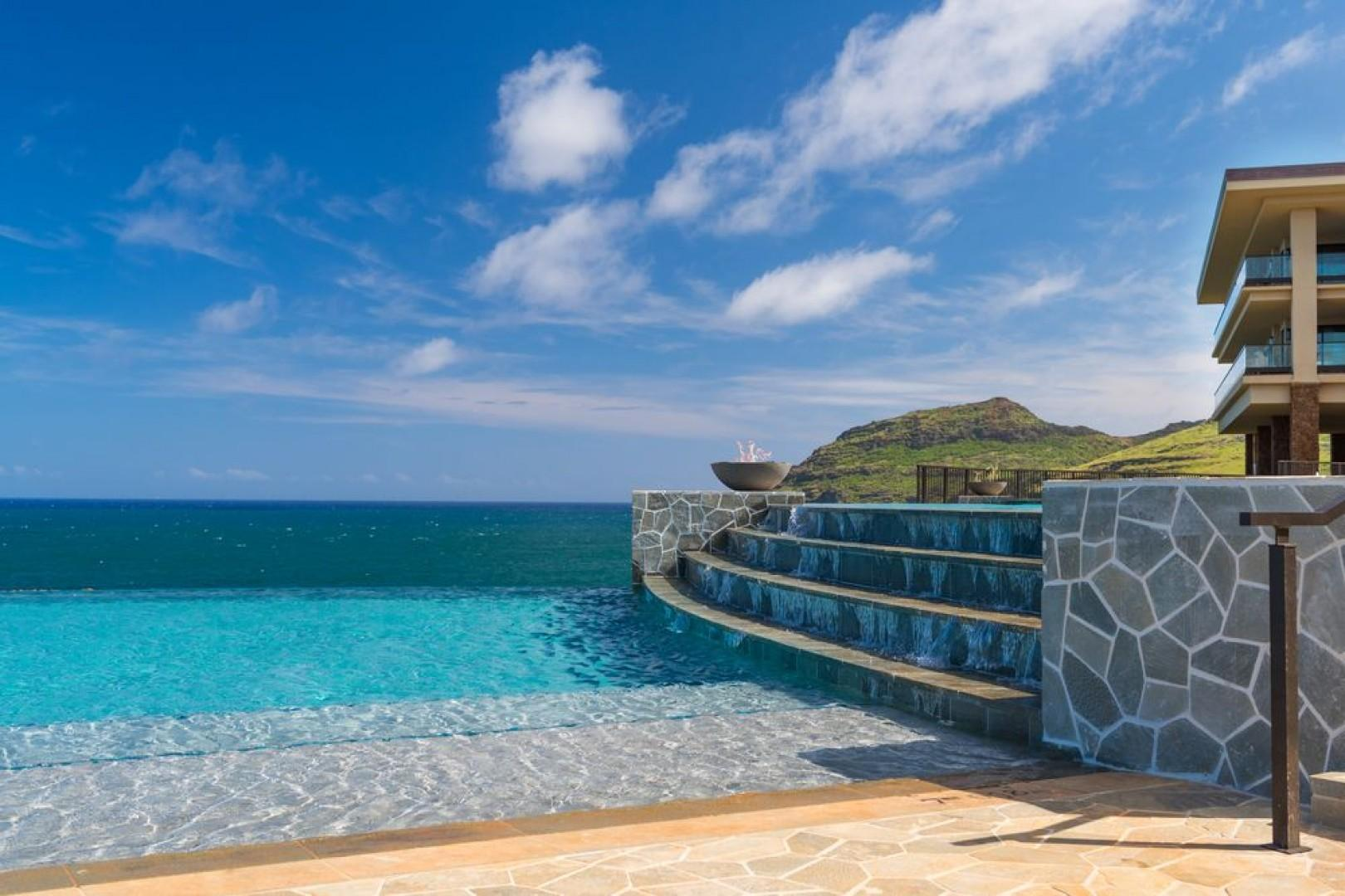 The two-tier, infinity-edge Kaiholo pool seems to flow right into the ocean.
