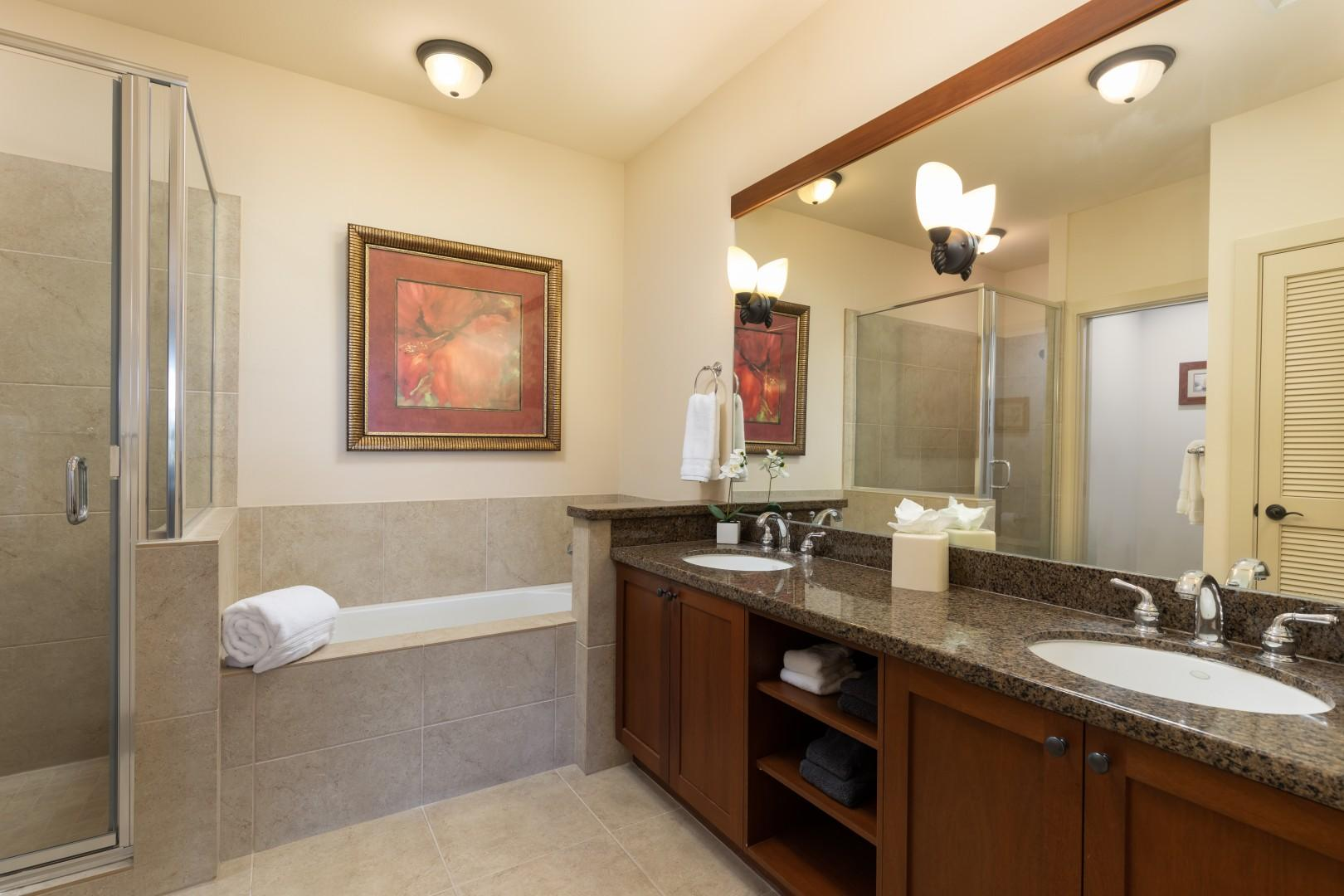 The master bathroom provides dual vanities and a great deal of space.