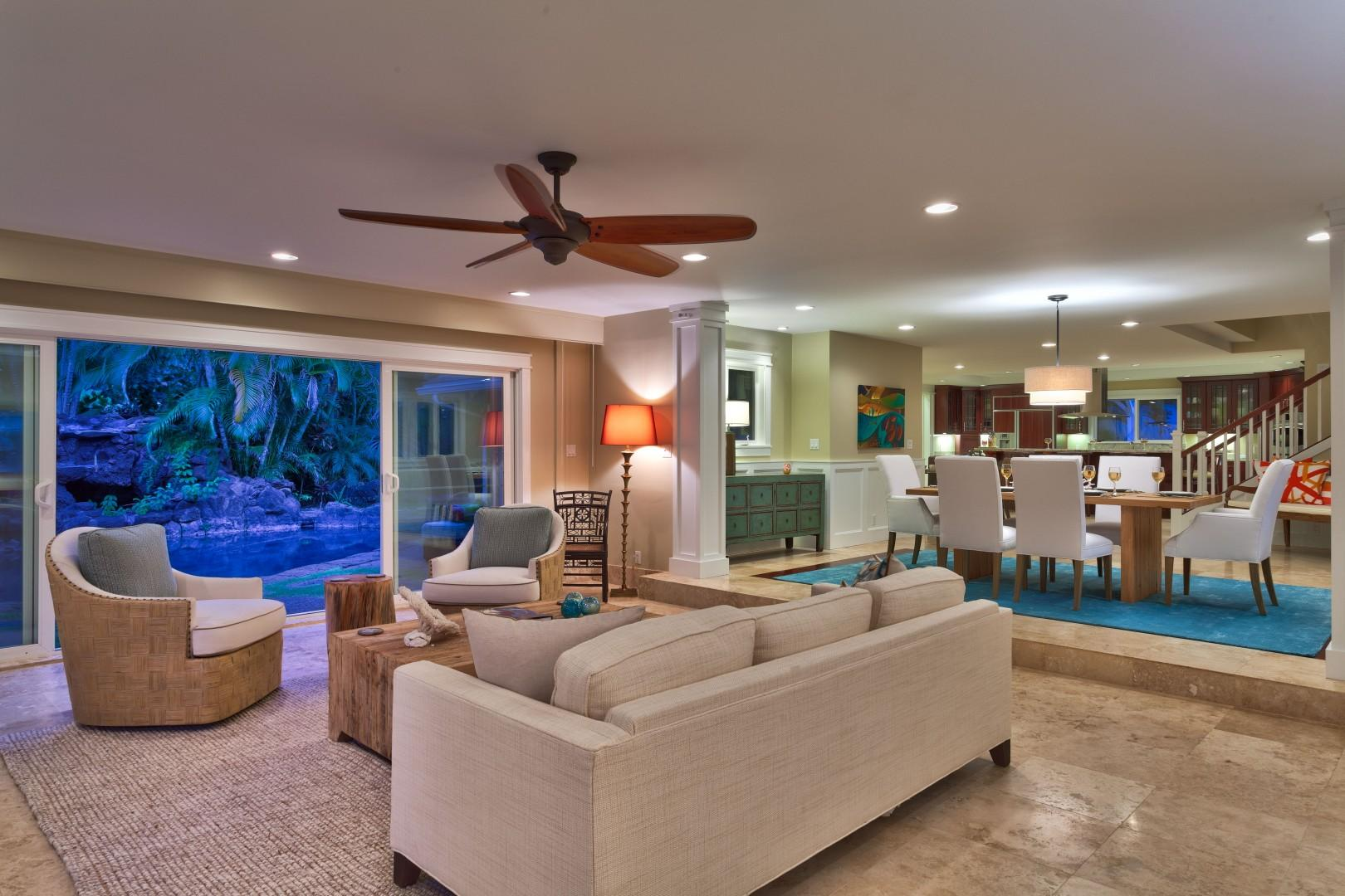 Views from the front door of the sitting room, pool deck with waterfall, dining room and further is the kitchen.