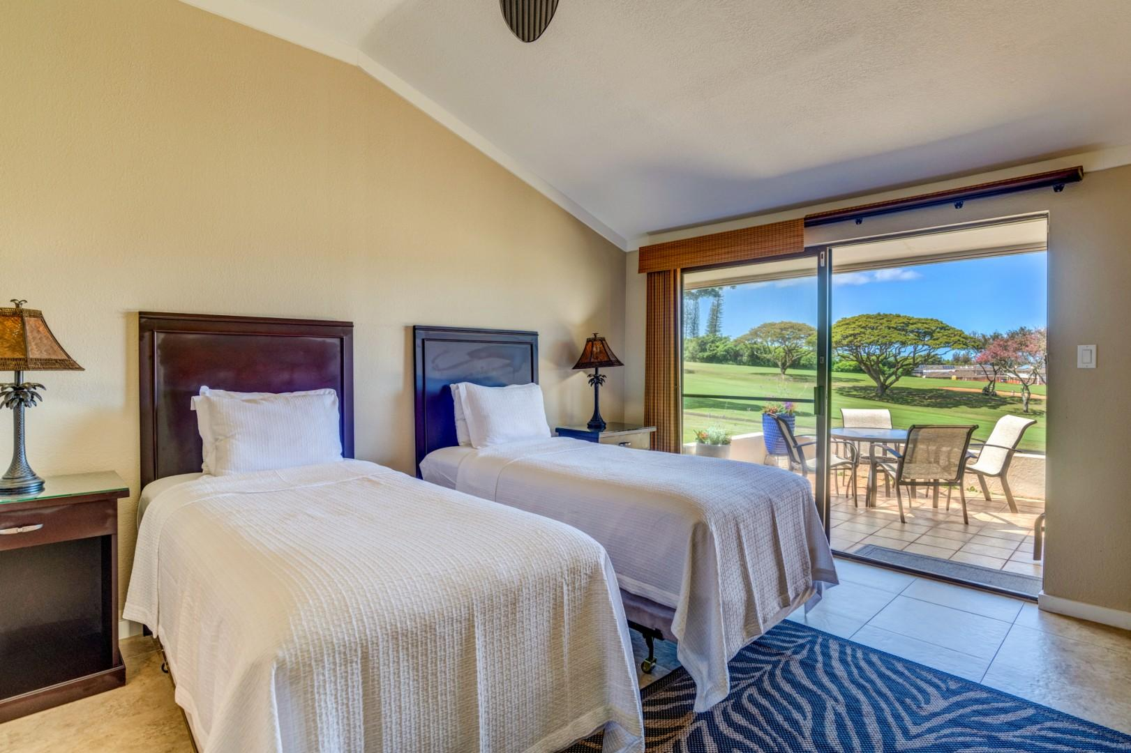 Guest bedroom equipped with twin beds
