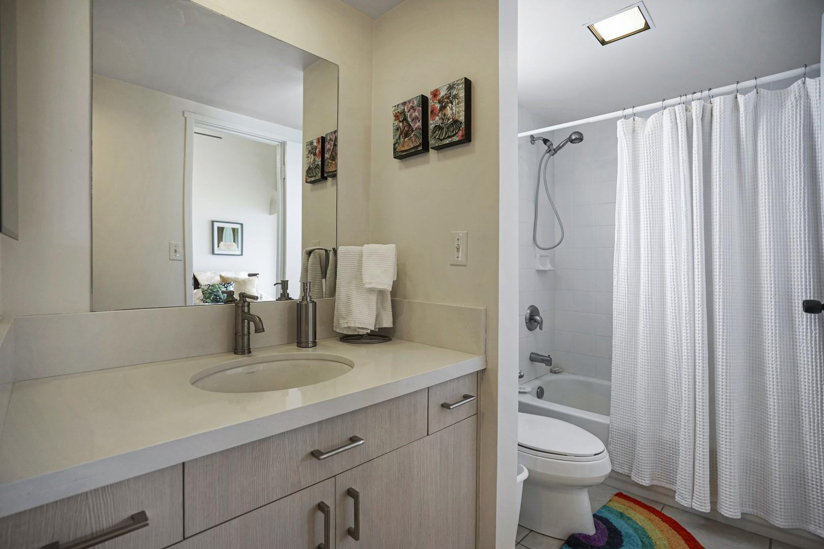 Both bathrooms have plenty of counter space