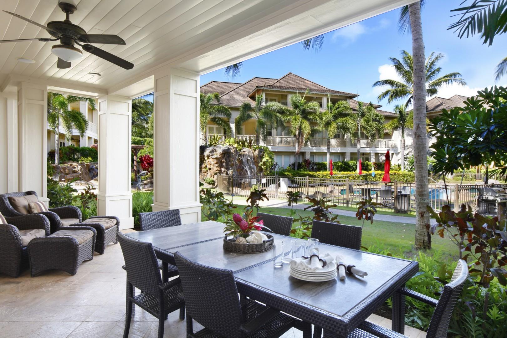 Lanai with pool and waterfall view.