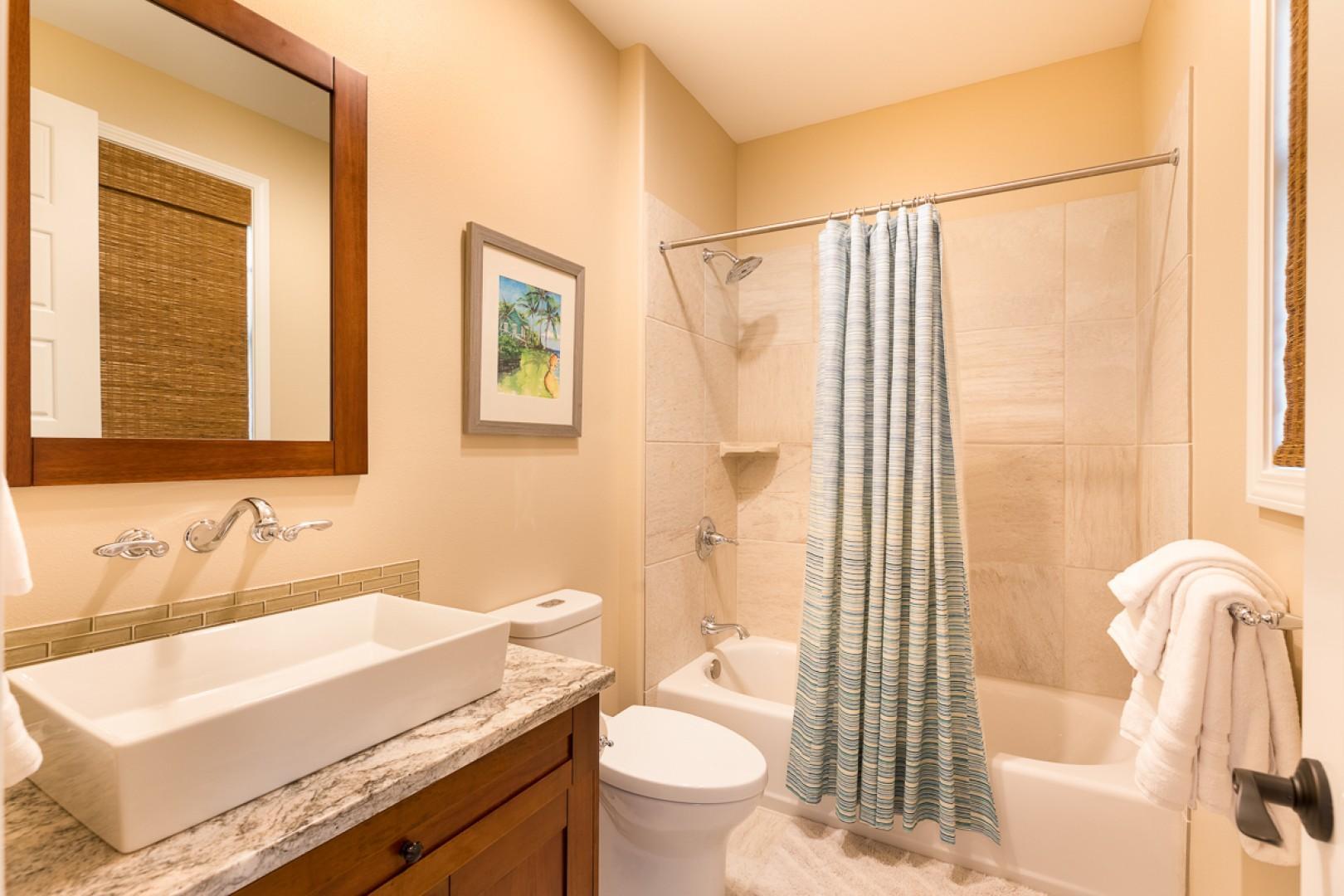 Bathroom three has a shower and a tub