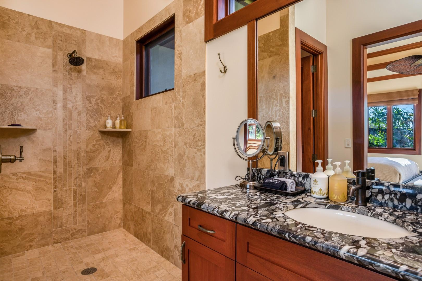 Second bedroom suite's full bath with walk-in shower and granite countertops.