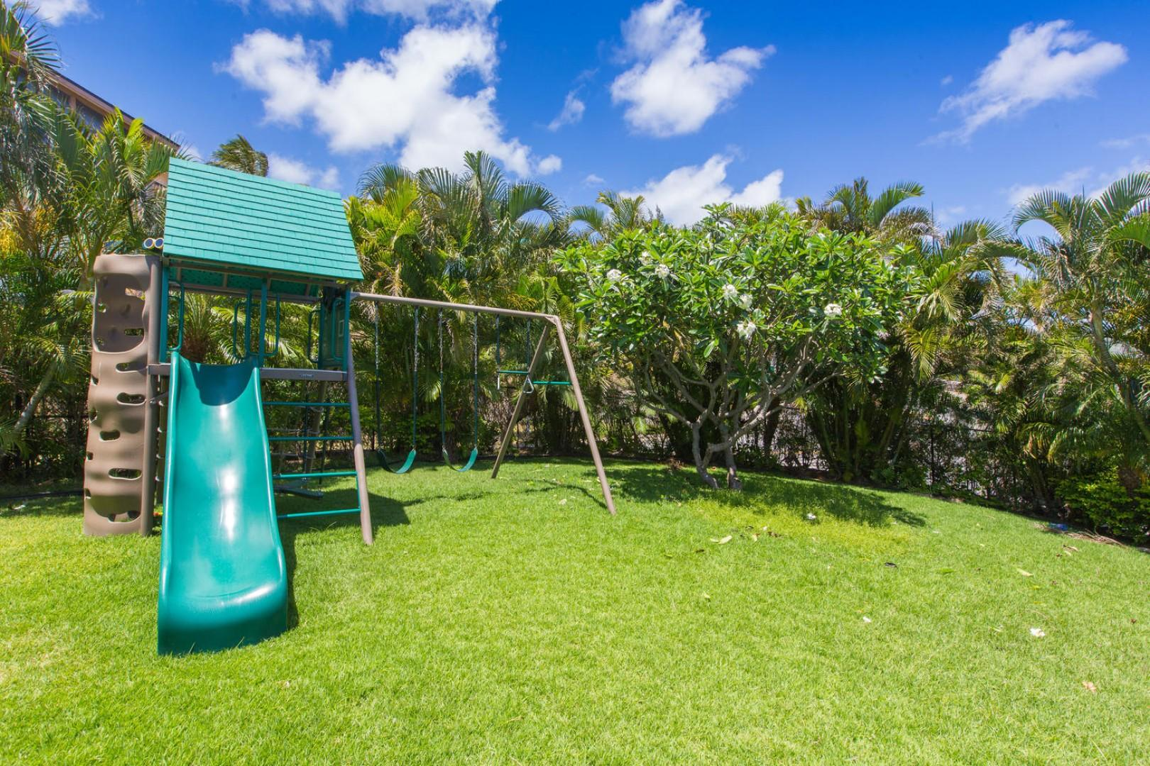 Play set on the upper level of the house (the grass slopes down and you can walk down to the pool level).