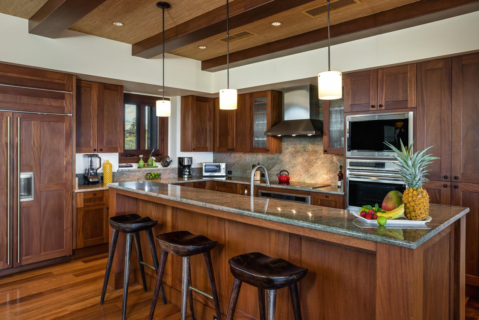 Gourmet kitchen with top-tier appliances and bar seating.