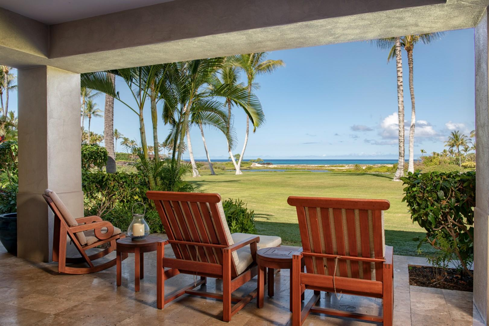 Closer view of lanai loungers with ocean views.