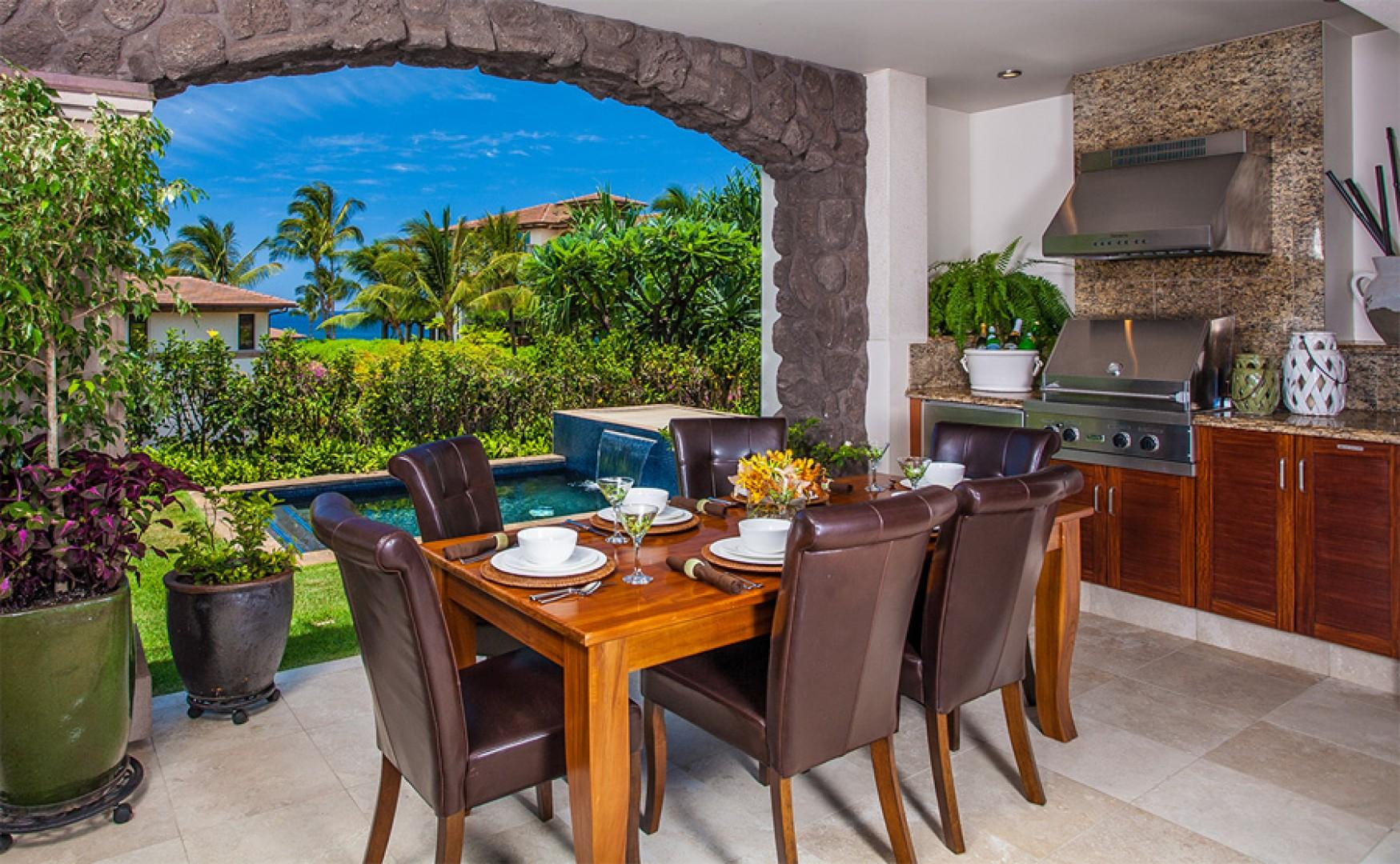 Covered lanai with lounge chairs, dining area, Viking gas barbecue grill, and refrigerator.