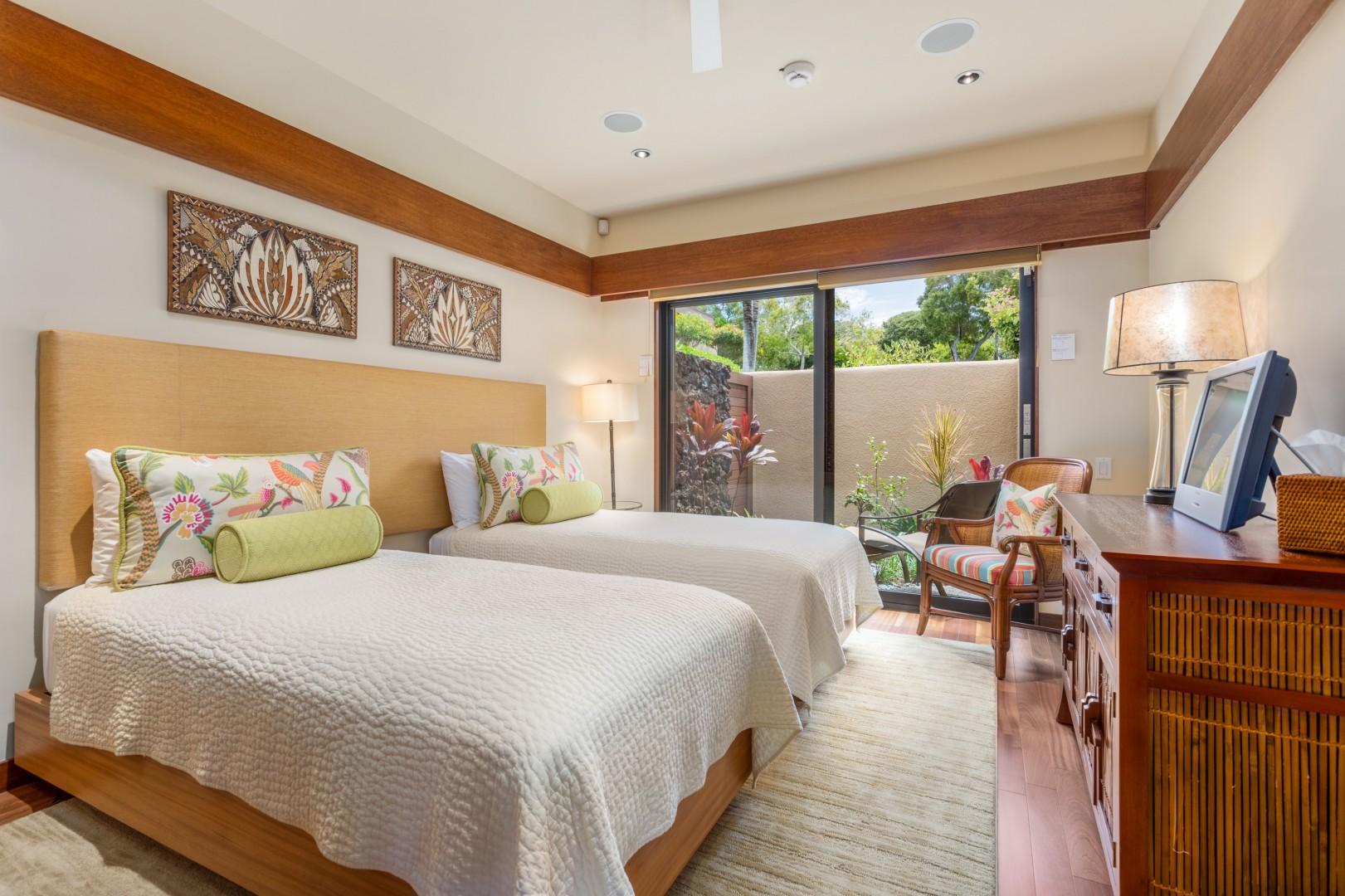Second Bedroom w/Two Twin Beds (can convert to King upon request), Flat Screen TV & Sliding Doors to Private Courtyard.