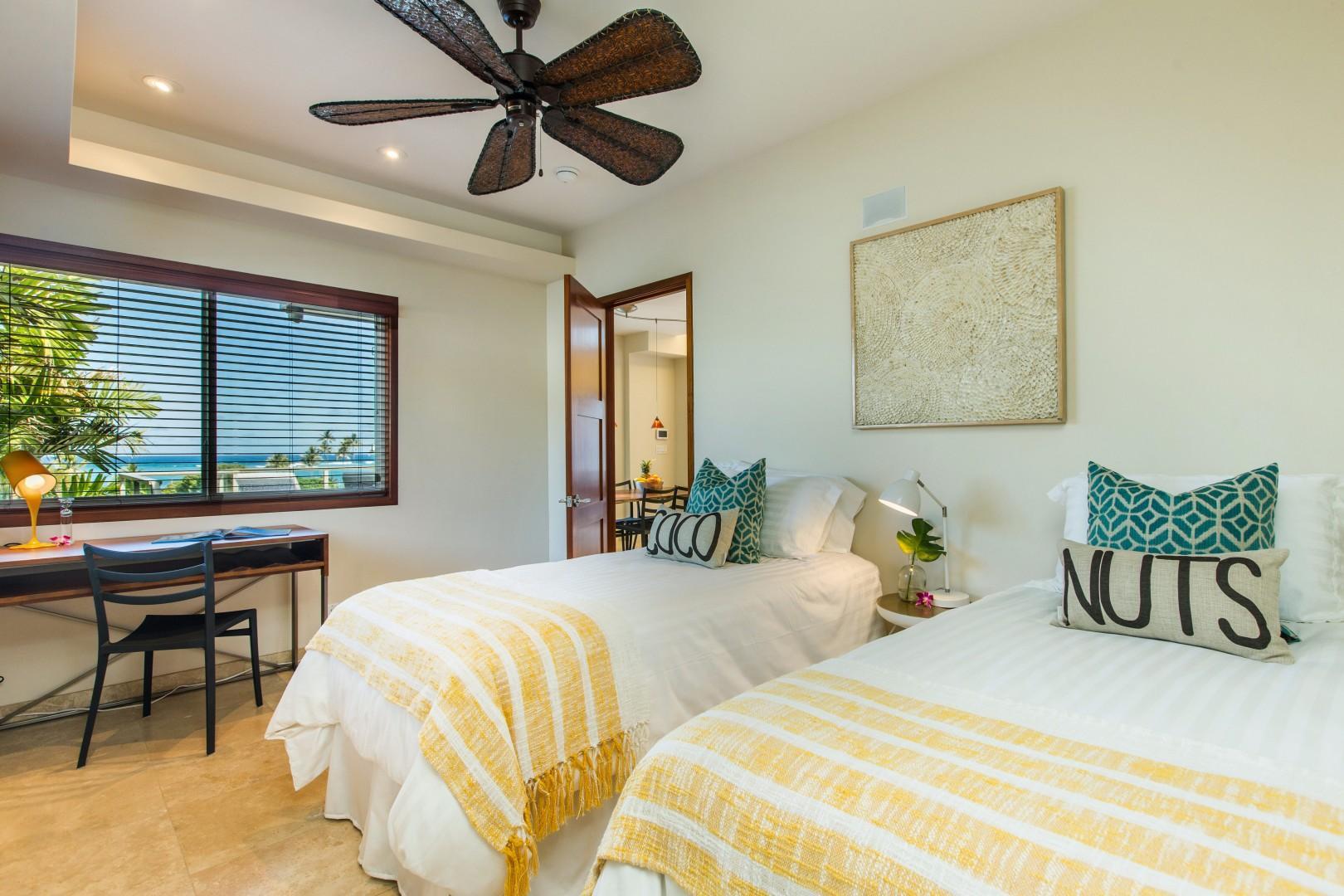 Twin bedroom with ocean views and en suite bathroom.
