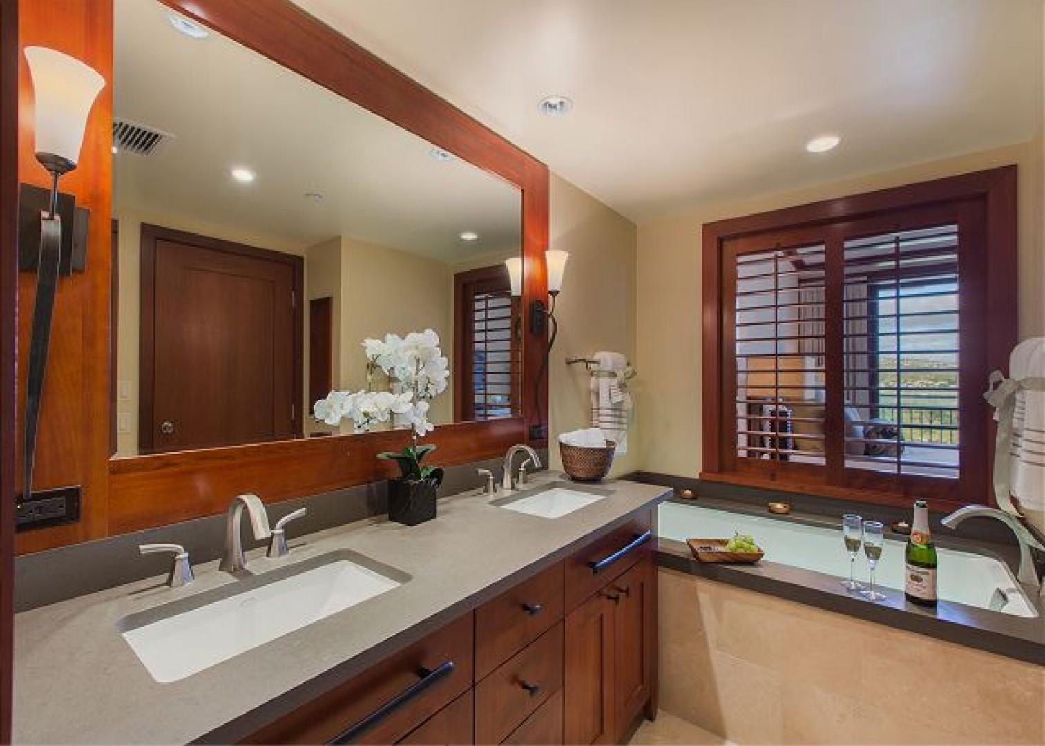 Master bathroom with shower and separate soaking tub. Includes d