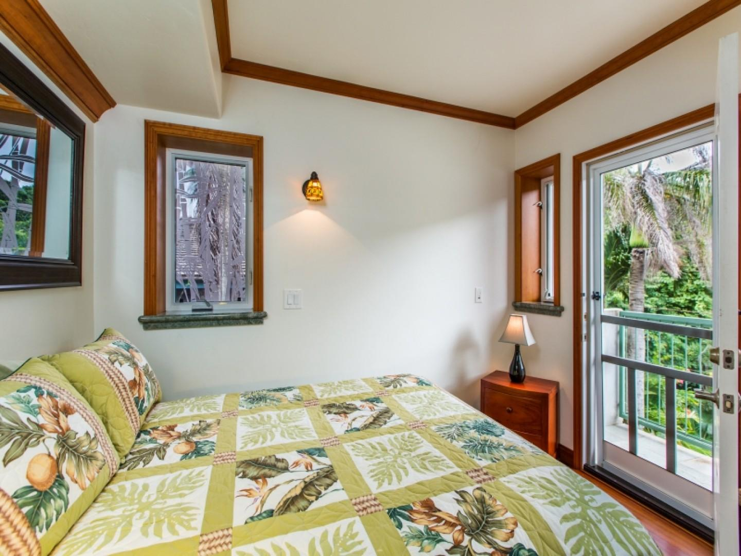 Bedroom with queen-size bed and private lanai.