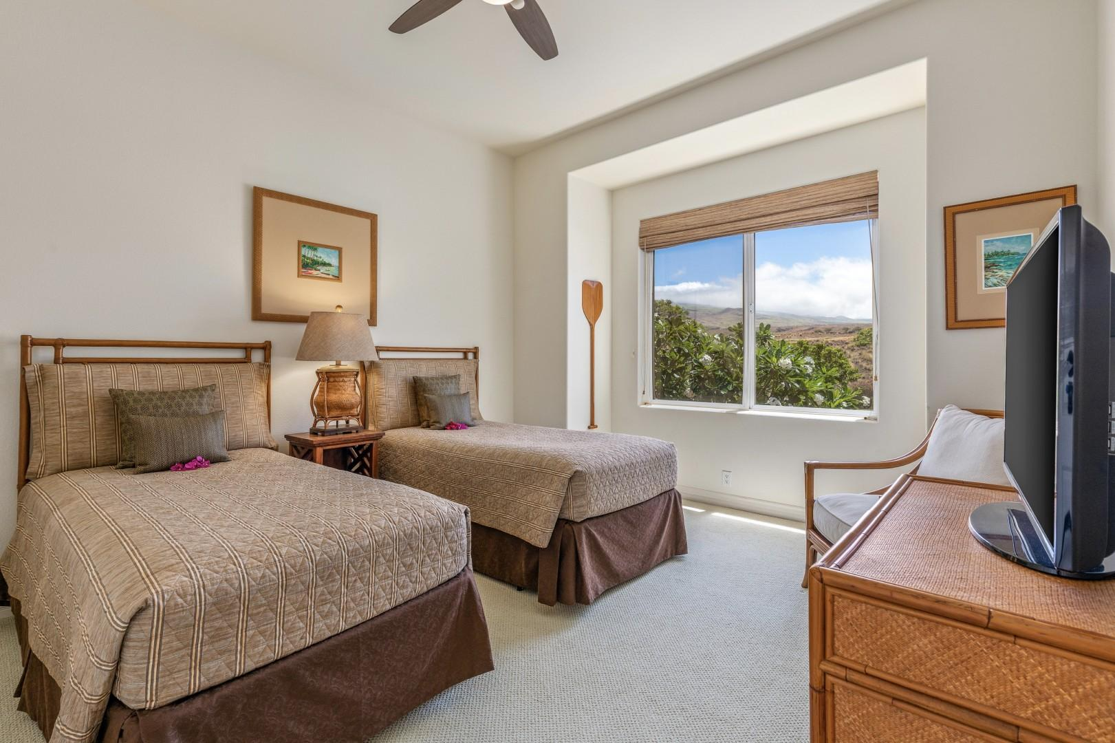 Guest room with two twin beds (can convert to a king upon request) andmountain views.