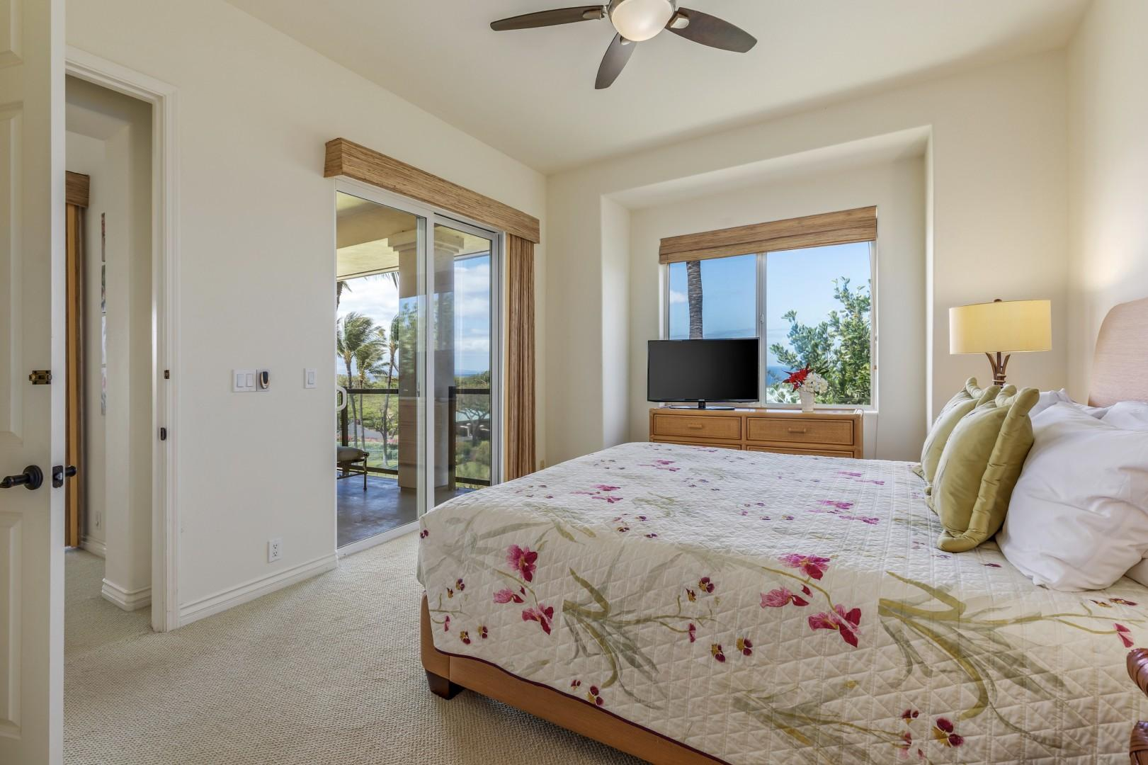 Spacious master bedroom with ocean views, lanai access and en suite bath.