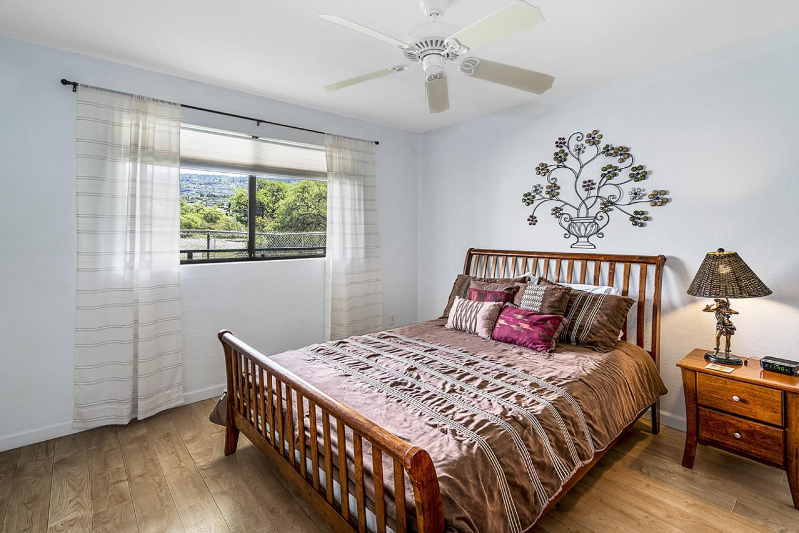 Guest bedroom with views of the sunrise and Queen sized bed!