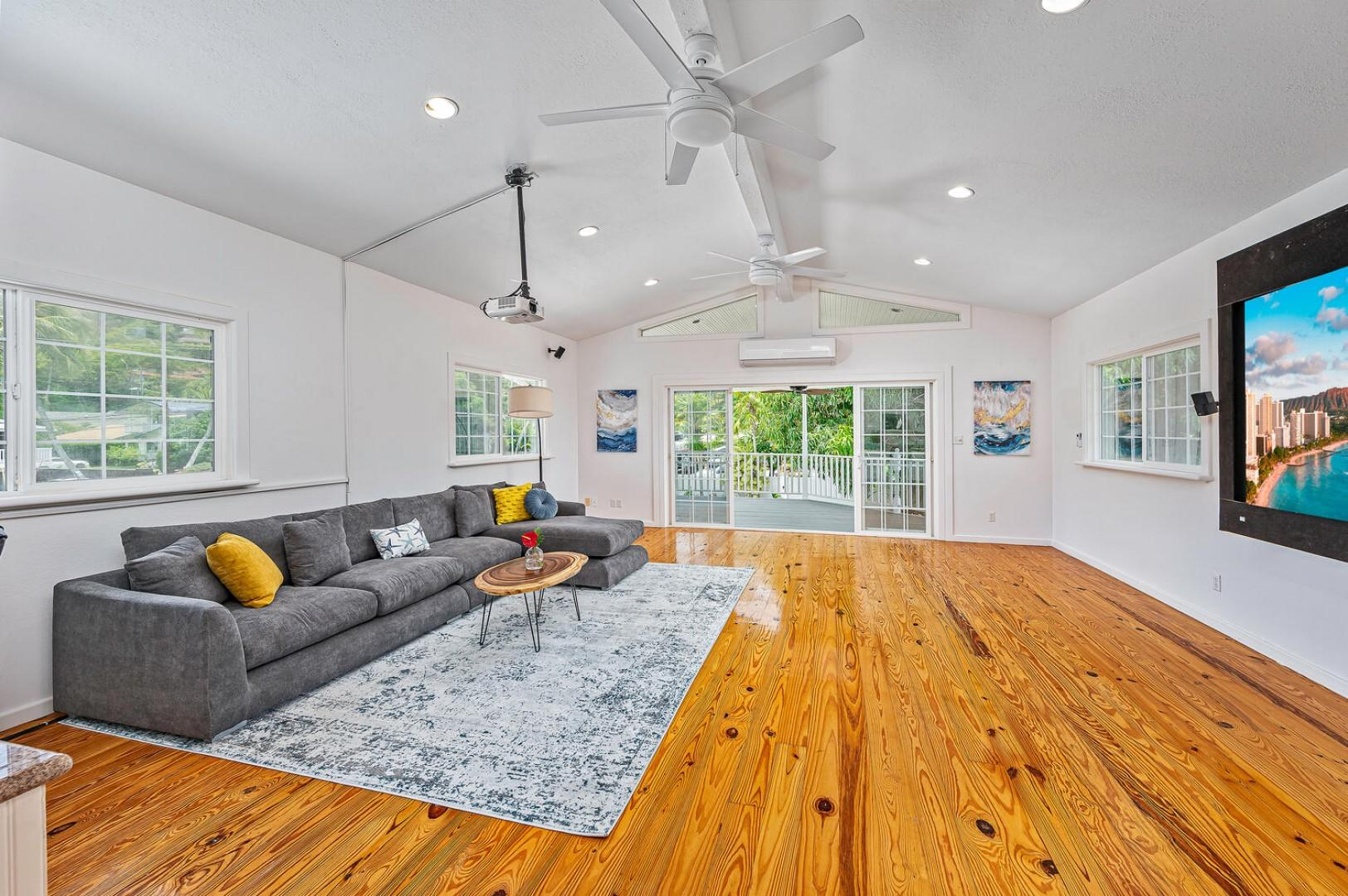 Media room with a large deck that has a birds eye view of the pool!