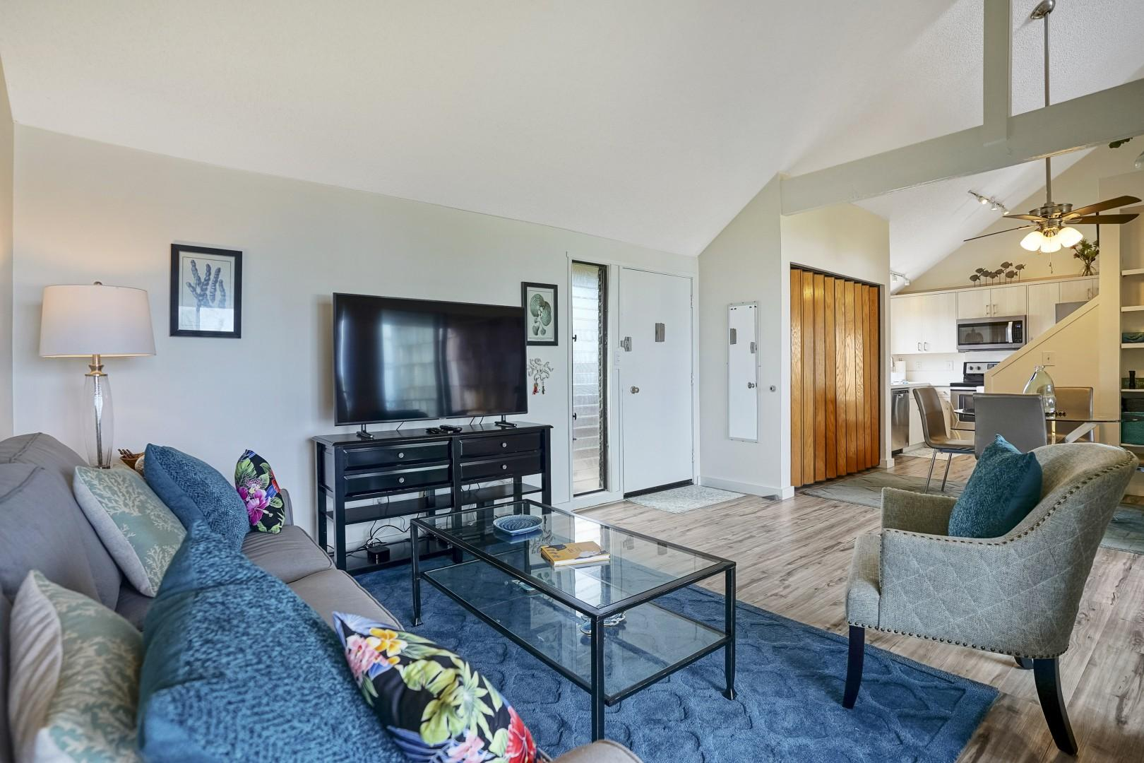 Open layout, beautiful decor, and a large television