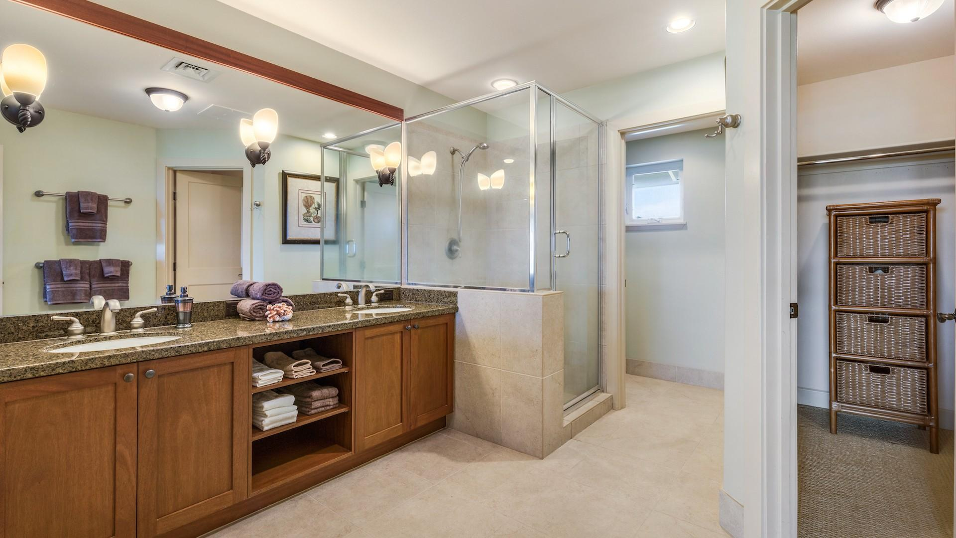 Master bath w/ walk-in shower and dual sinks, separate toilet room and walk-in closet.